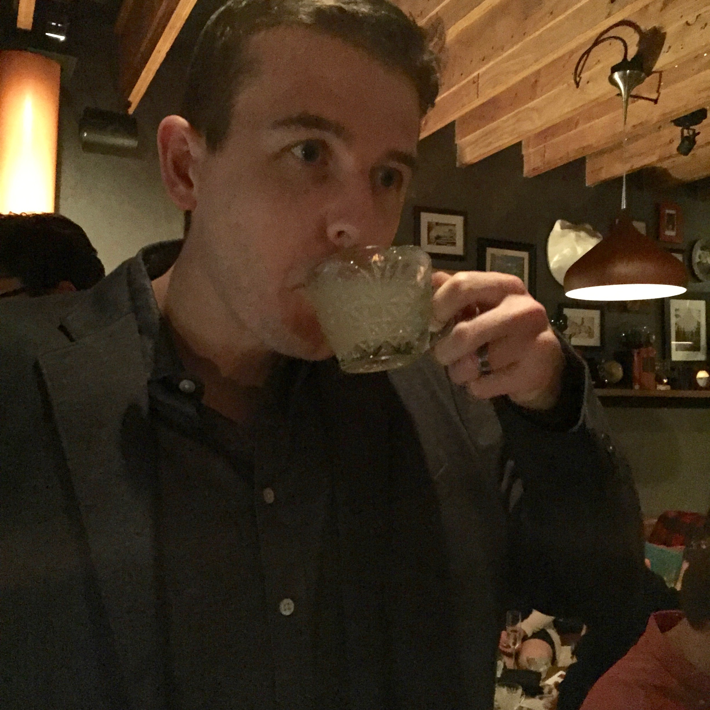 My husband enjoying his first round of punch in a little tea cup