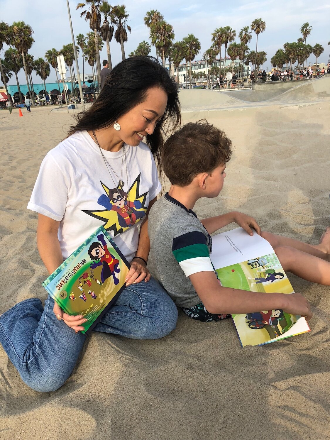 JENNIFER NORMAN with gavin mchugh, venice beach. cerebral palsy doesn't stop gavin from surfing or pursuing his dreams.