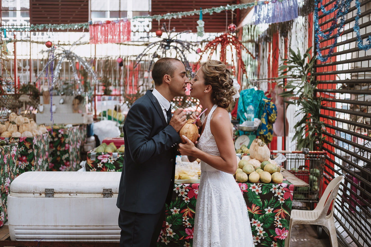 bride and groom kissing in tahiti markets