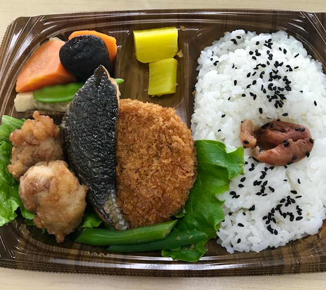 Yummy bento box lunch, complete with salmon, rice, veggies, and a bunch of things I couldn't identify.