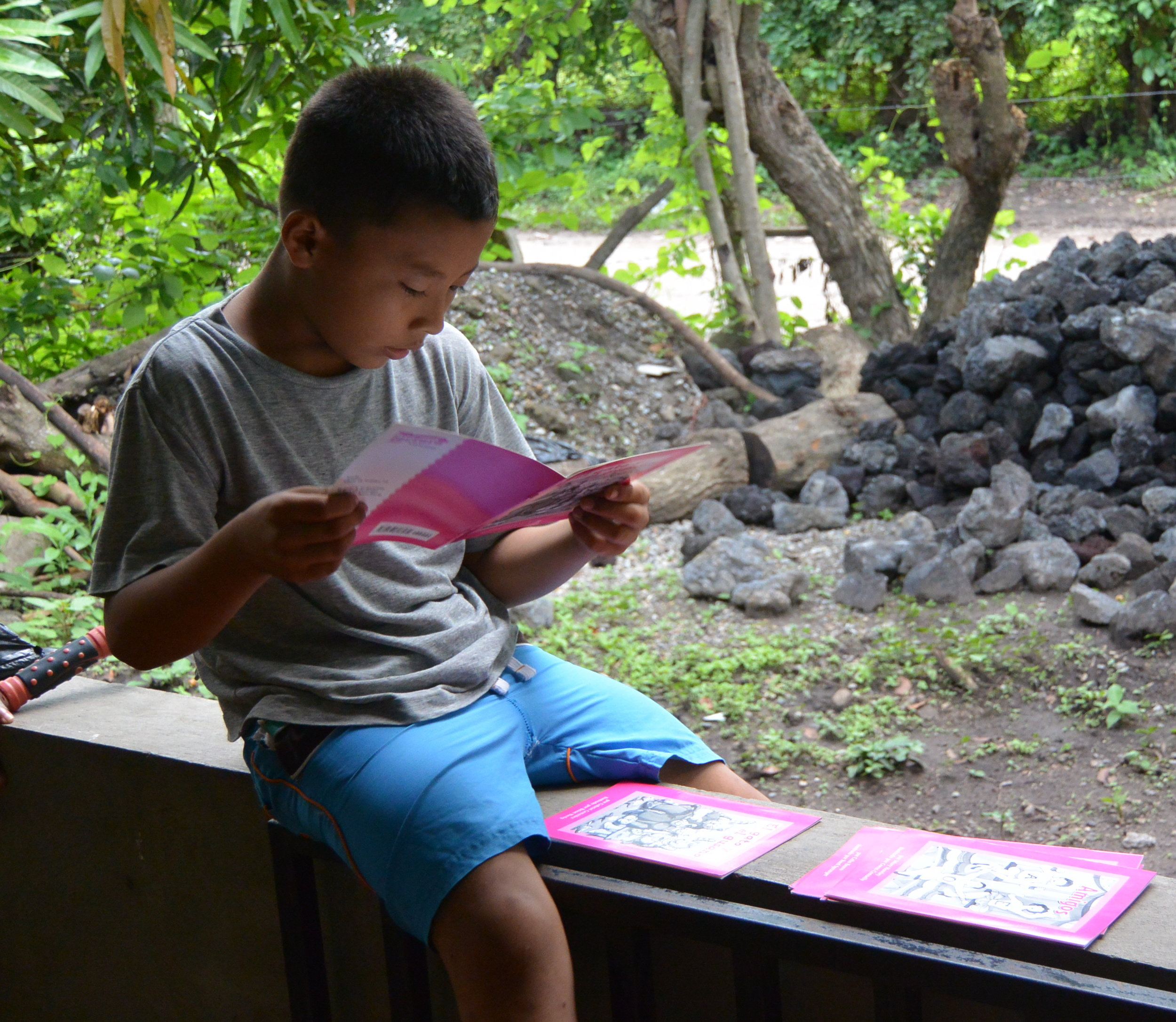 Enjoying access to books for the first time! Izote created community library in San Hilario