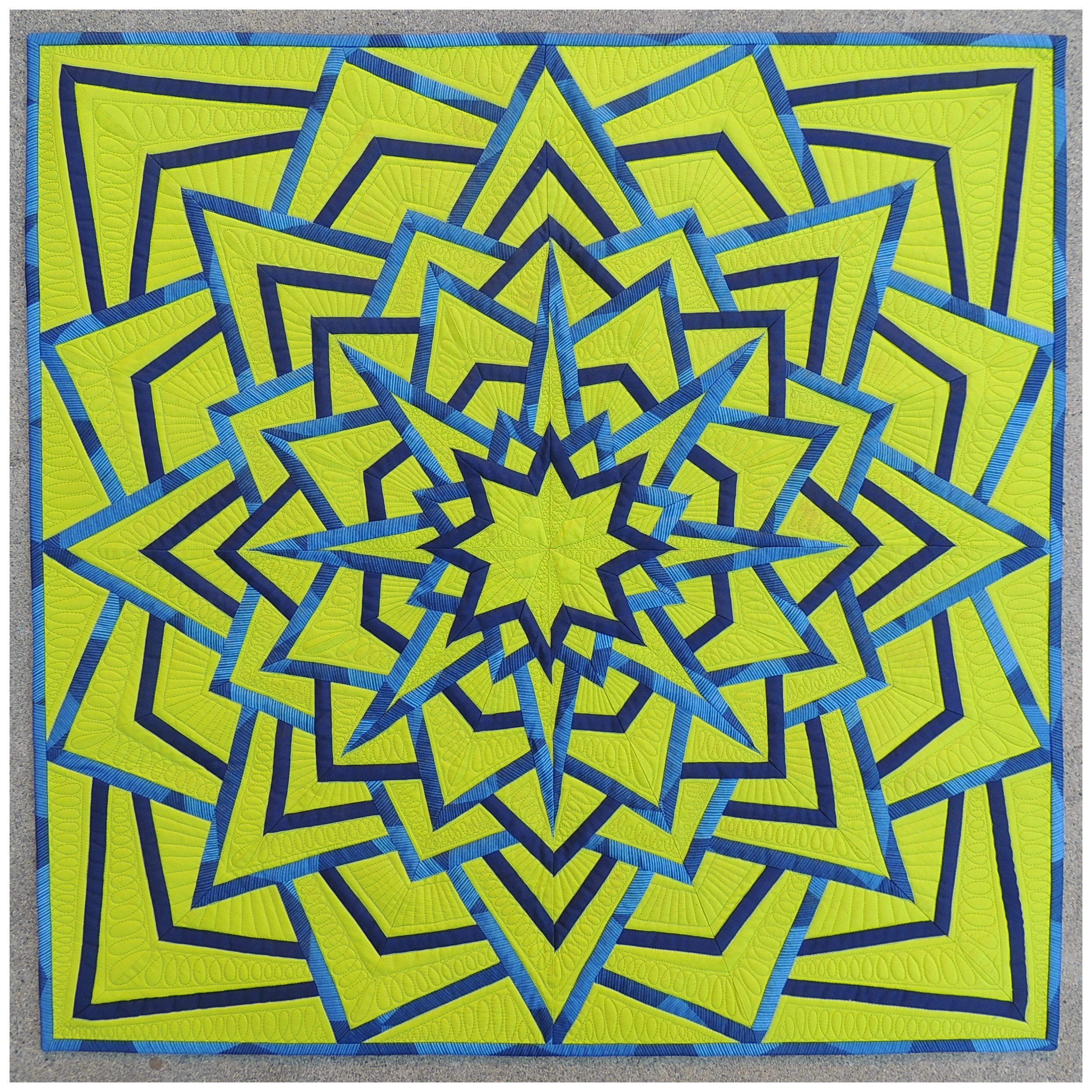 "13. Lime Light, Star Bright  November 2016 31"" x 31"" Pieced Modern Mandala made using Michael Miller solids & prints.  Exhibits/Awards: 2nd Place in Pieced Quilts at the California State Fair (July 2018), juried into Quilt Con (February 2017) and Pacific International Quilt Festival (October 2017).   Blog Post"