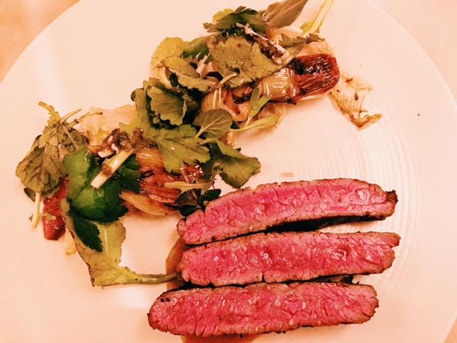 Oregon wagyu steak,    spring onion, basil, boquerones
