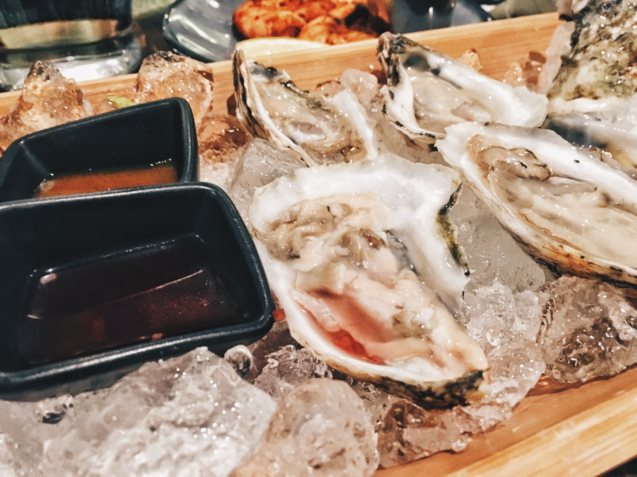 Oysters with hot sauce, mignonette, lemon and house remoulade ($1 each for happy hour)