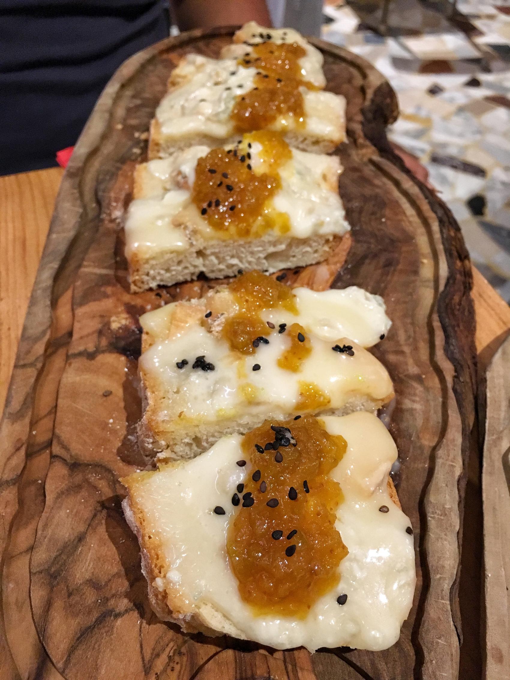 Gorgonzola cheese with fig jam on crostini