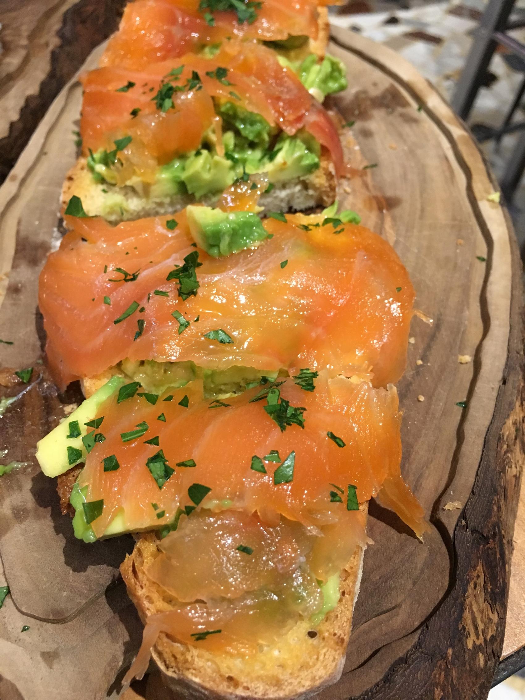 Smoked salmon with avocado on crostini