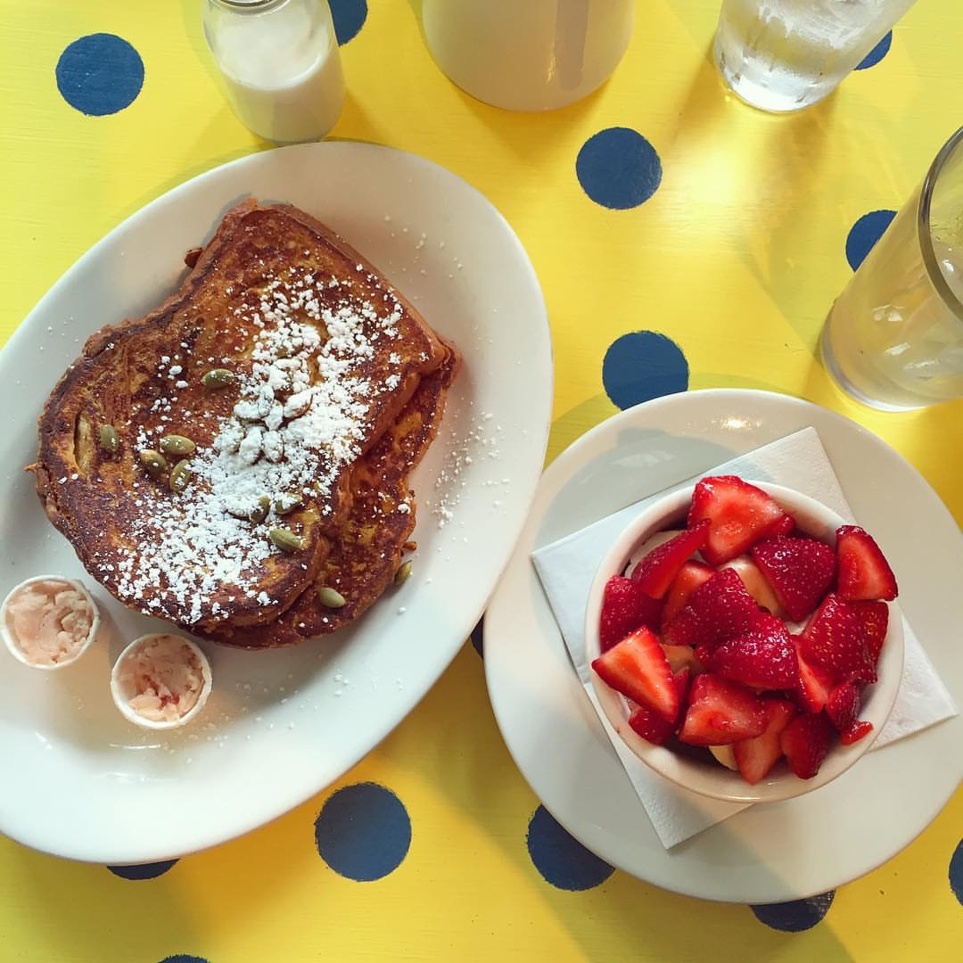 Pumpkin french toast with whipped strawberry butter and a side of strawberries PC: @spooncolumbia