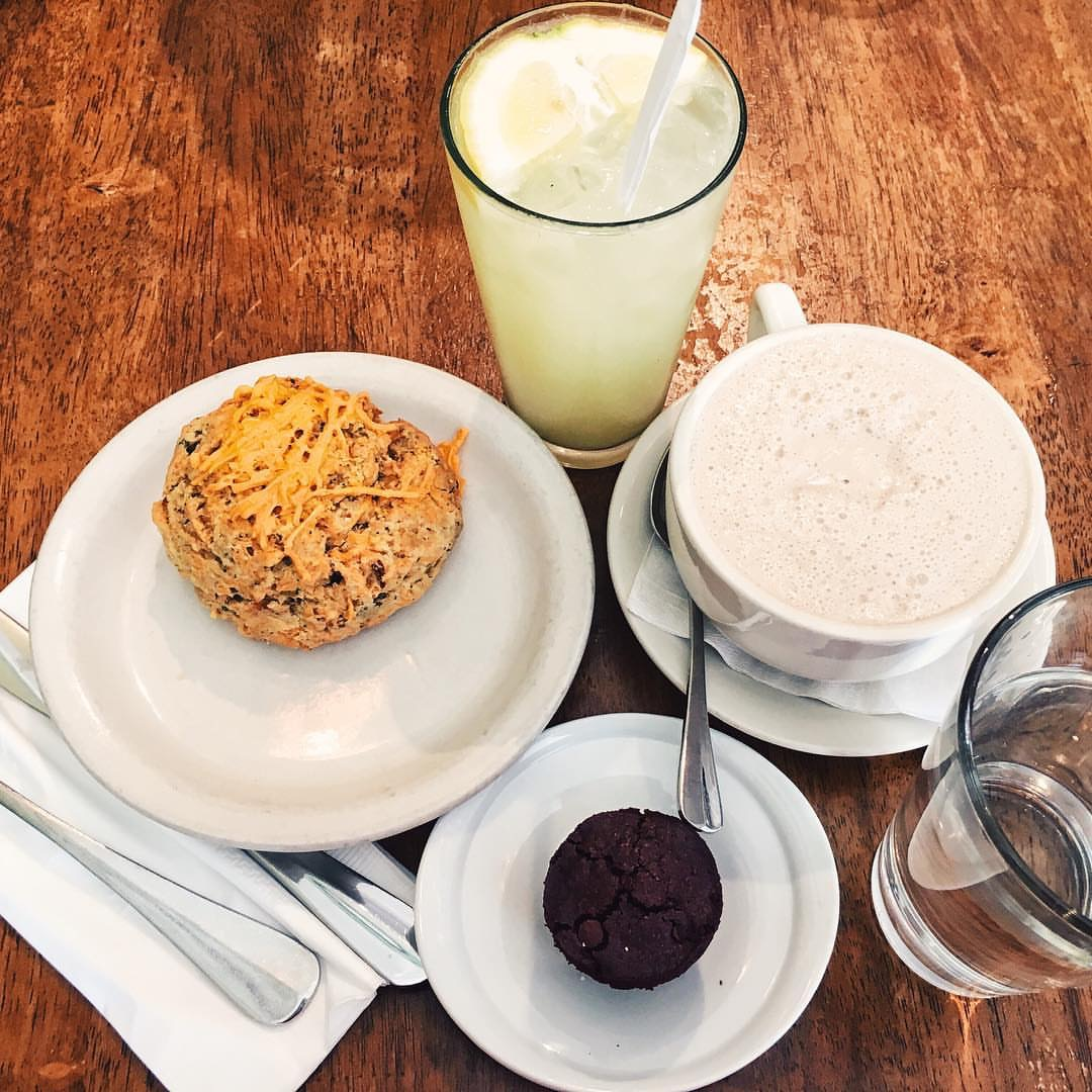 "Brazilian nut chai, ""wake up"" juice, mini brownie, ""cheddar"" biscuit"