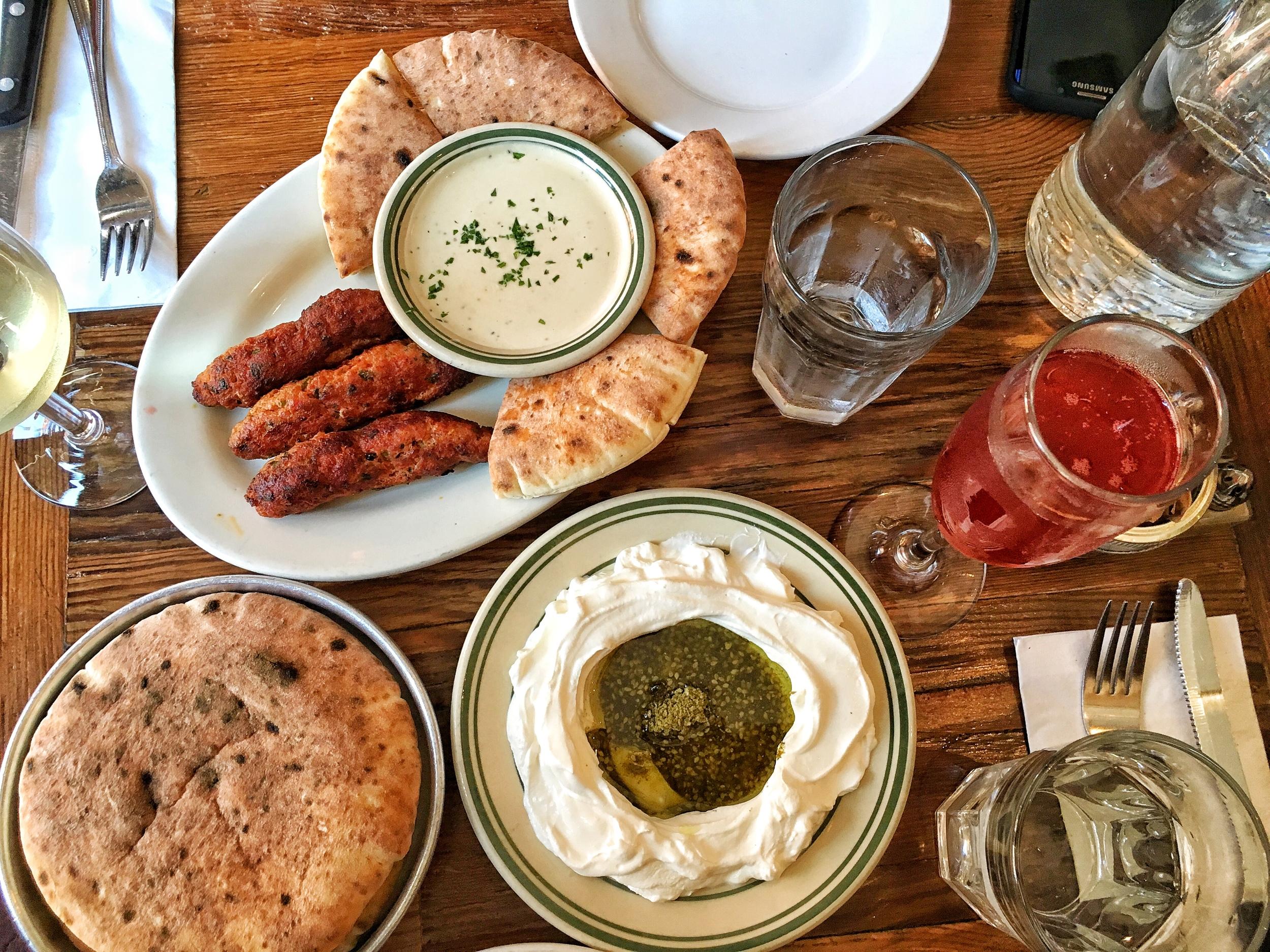Labneh, warm freshly baked pita bread, lamb kebabs with tahini and pita, chardonnay, pomegranate mimosa