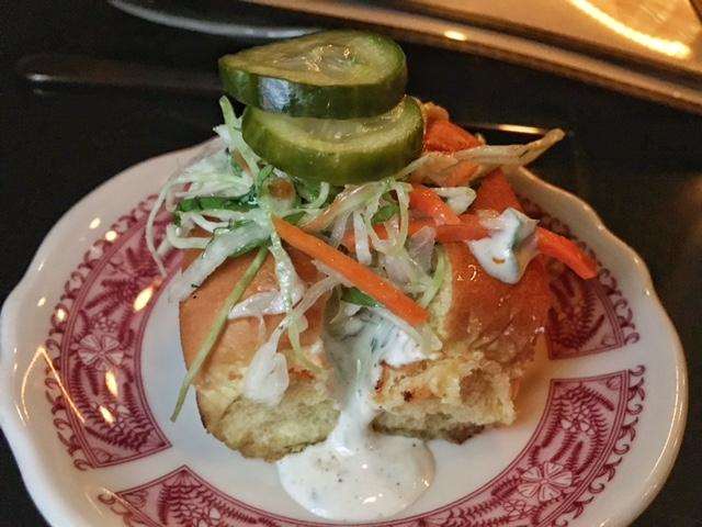 Nashville hot bun- fried chicken, little pickles, ranch, pickle brine slaw