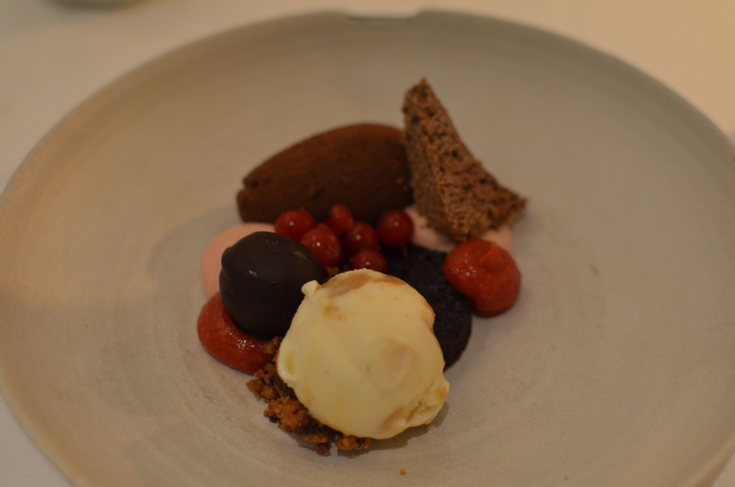 Chocolate mousse with red berries, dolce di latte ice-cream and sauce of hazelnut