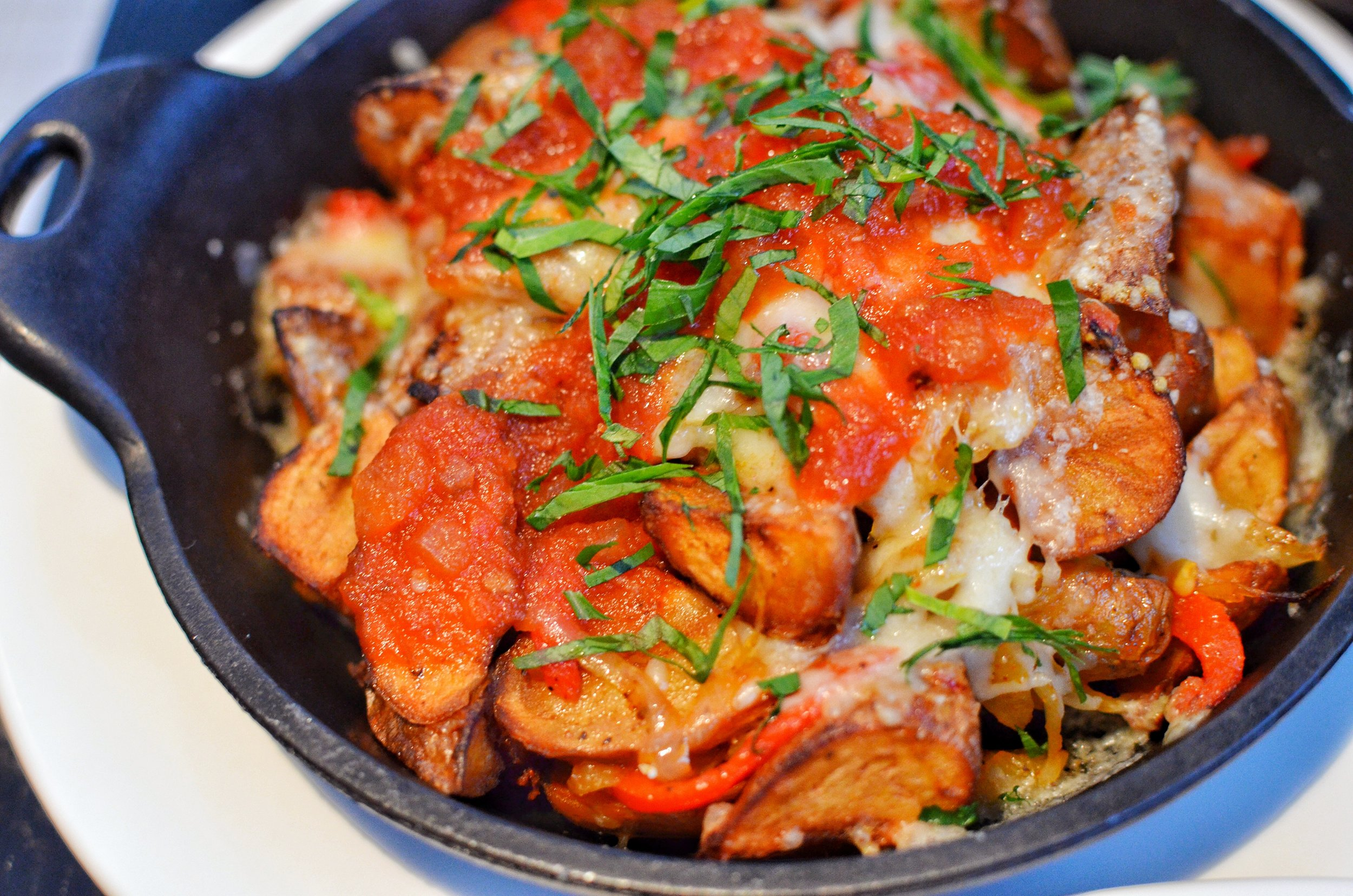 Potato hash with roasted bell peppers and cheese