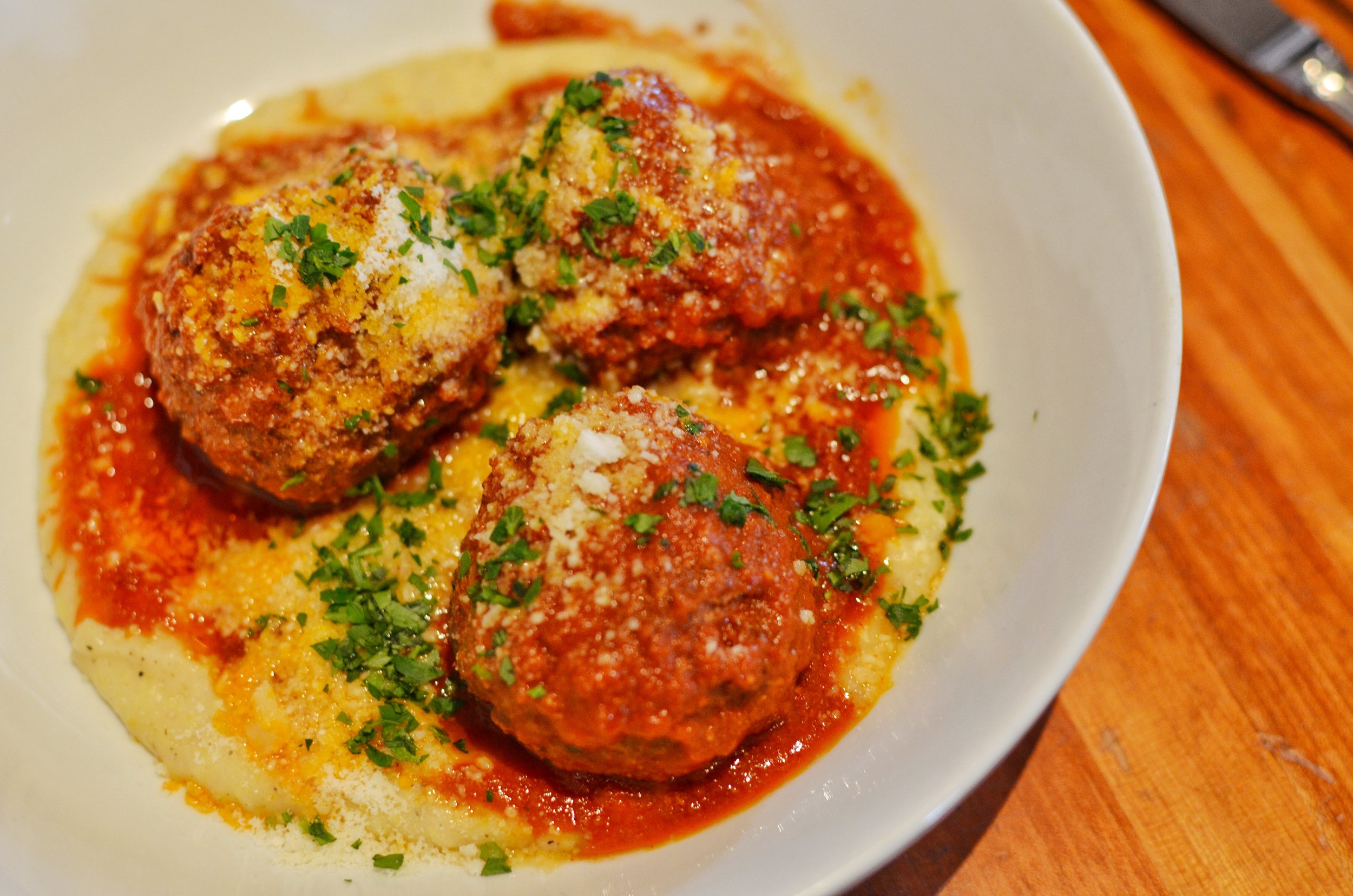 Beef and ricotta meatballs with creamy parmasean polenta