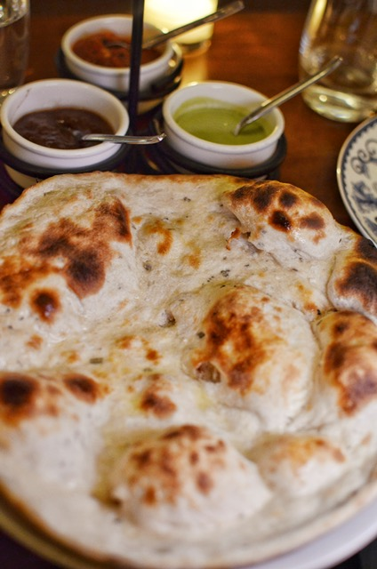 Rosemary naan with sides of tomato kalonji, tamarind, mint-cilantro