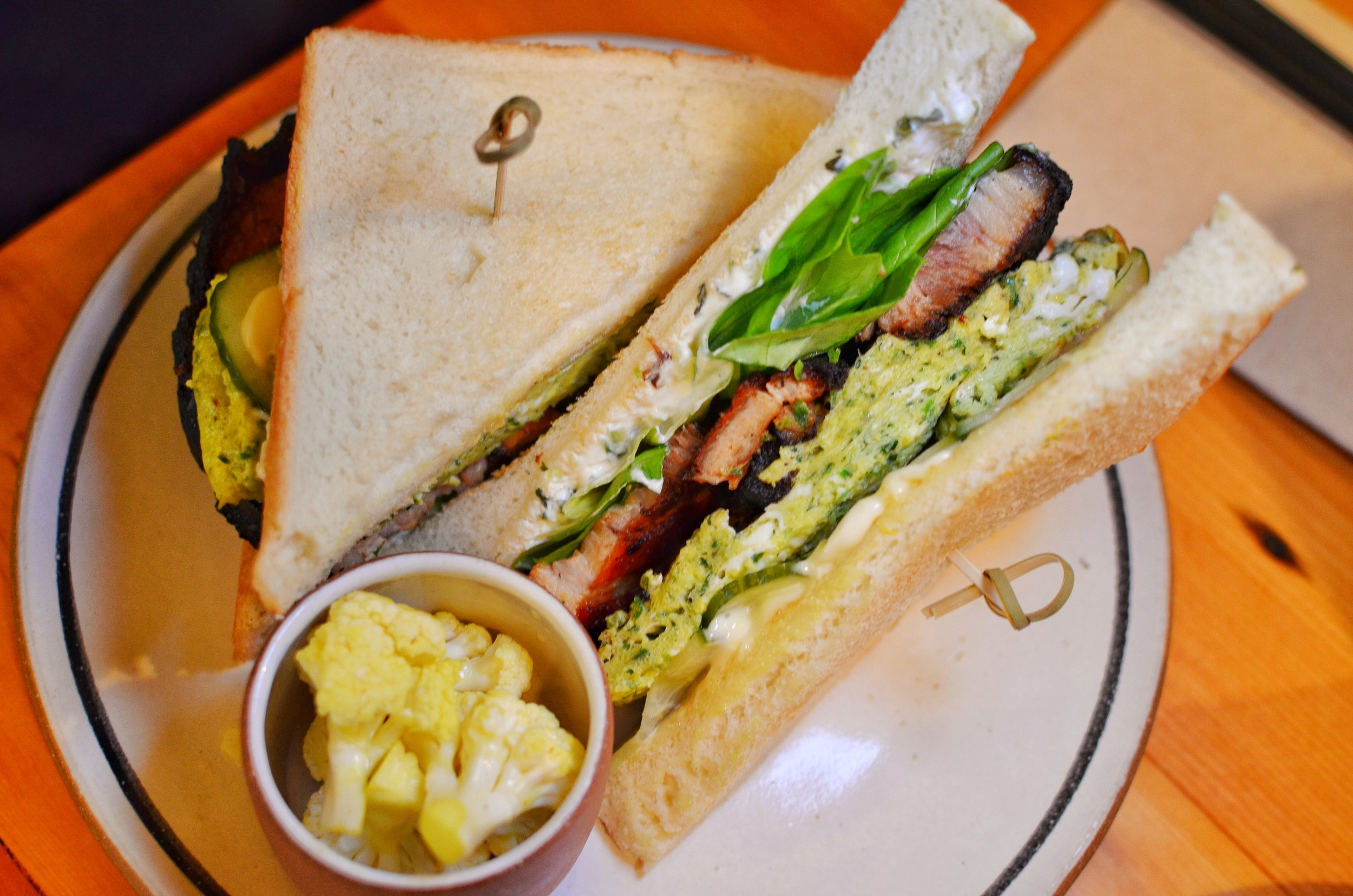Green eggs and chaashuu sandwich- herbed scrambled eggs, tomato braised Berkshire pork belly, cucumber, kewpie mayo on thick cut milk toast