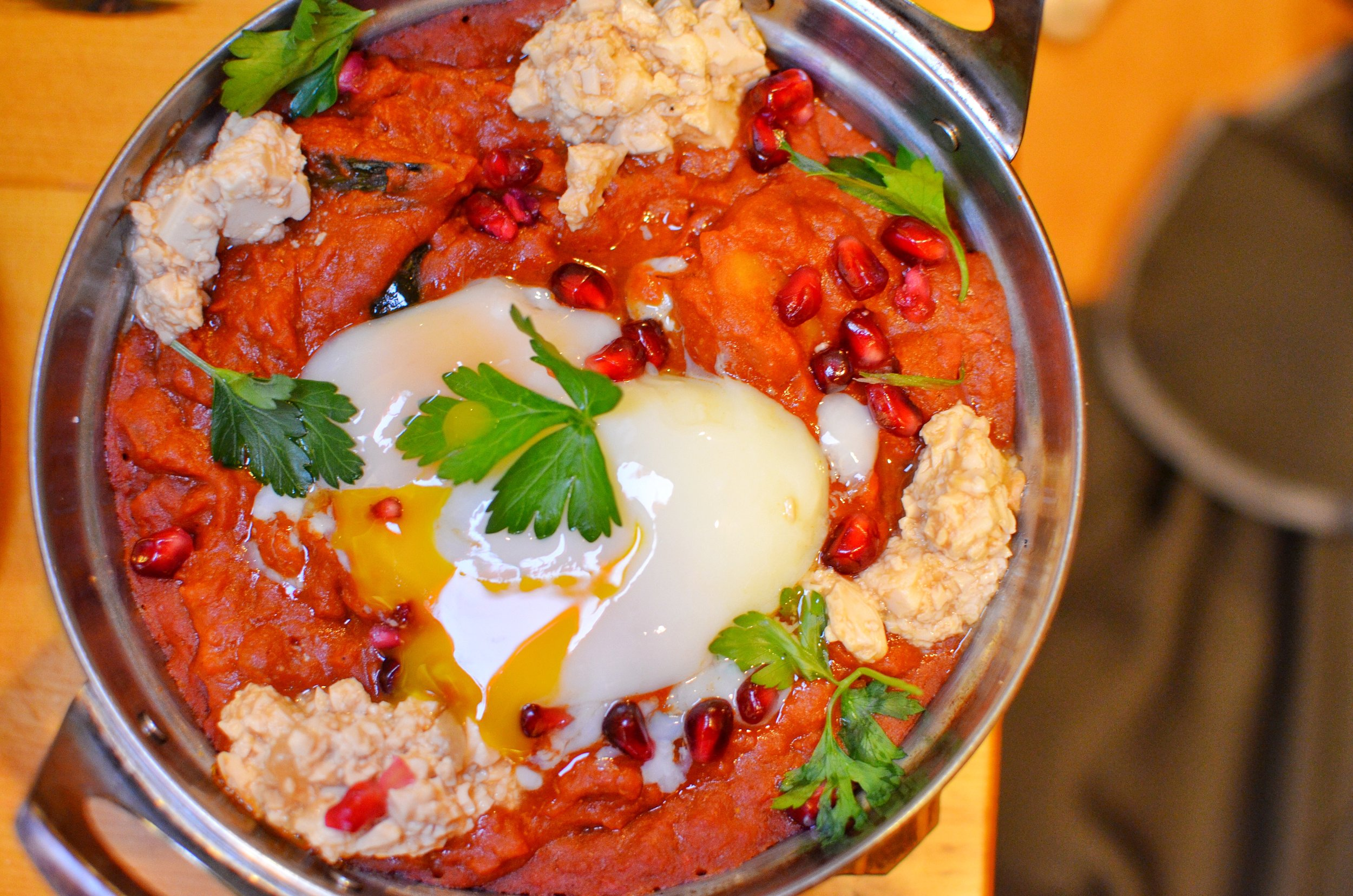 Kabocha Shakshuka- curried kabocha, baked eggs, miso labne, poached eggs, side of thick cut milk toast