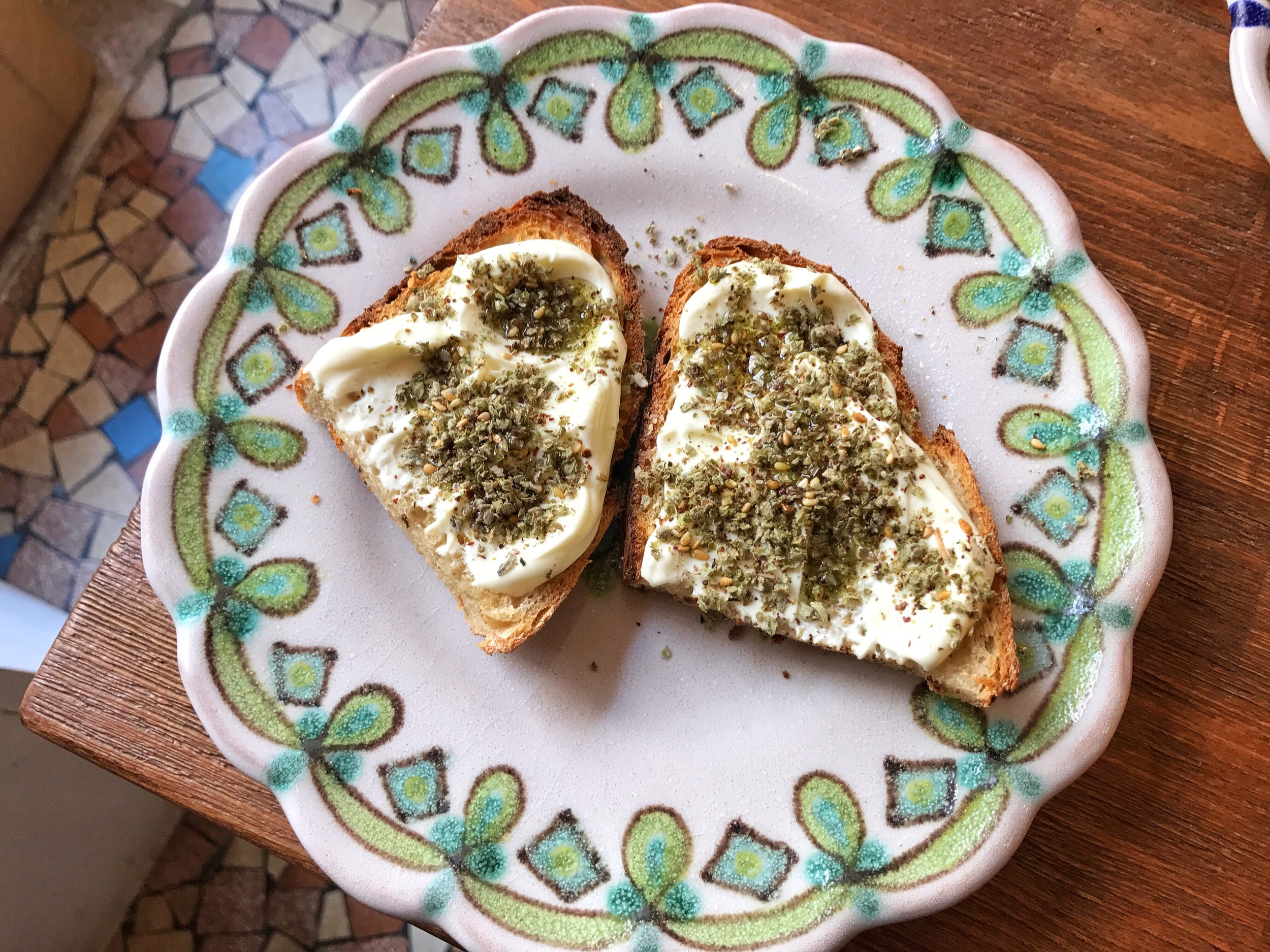 Labne with za'atar on toast- The labneh was delicious, creamy and had the perfect amount of za'atar on it.