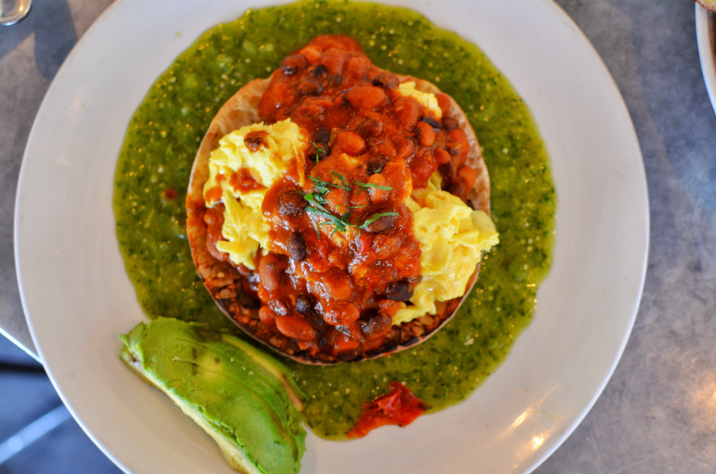 Virage Rancheros- 2 eggs, red & black beans, matbucha, salsa verde, pita