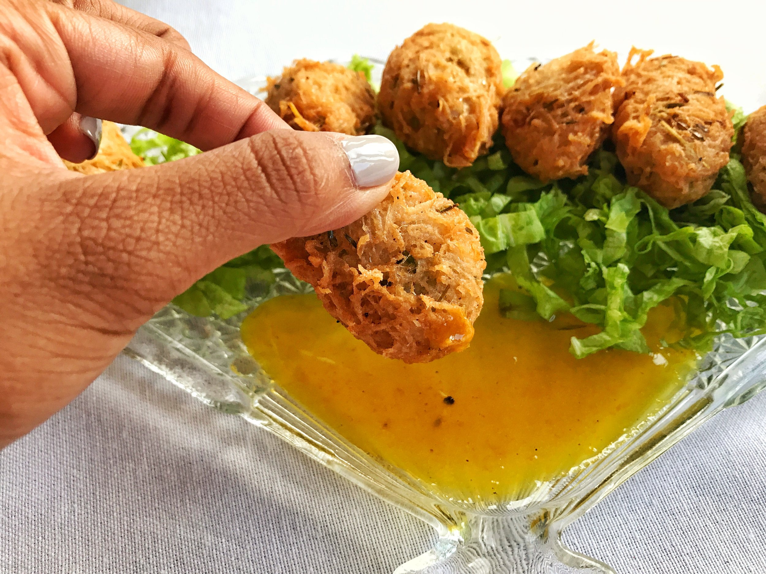 Mixed seafood fritters with a citrus glaze sauce for dipping