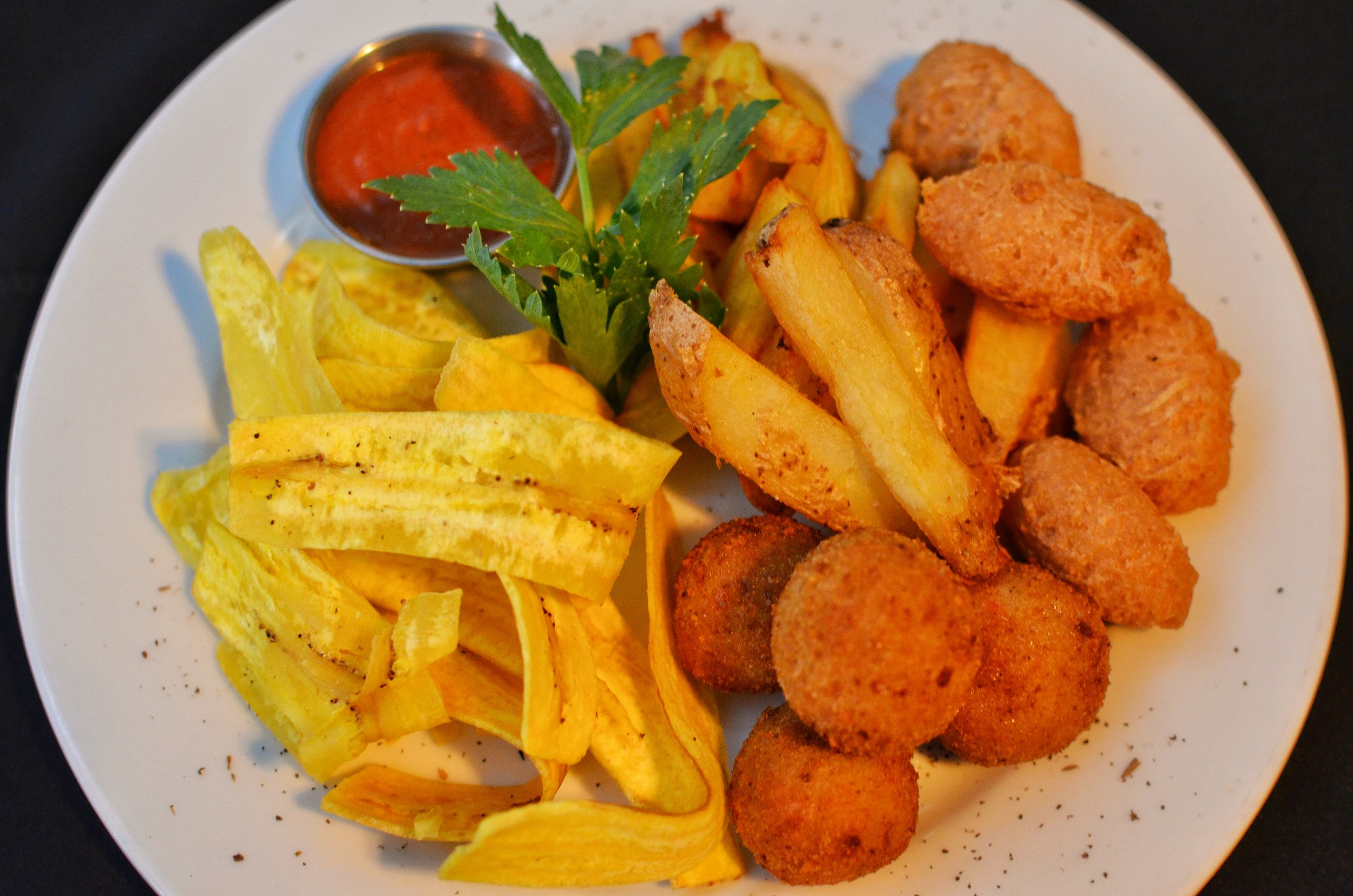 Appetizers included fried balls with taro, yuca fries, plantain chips