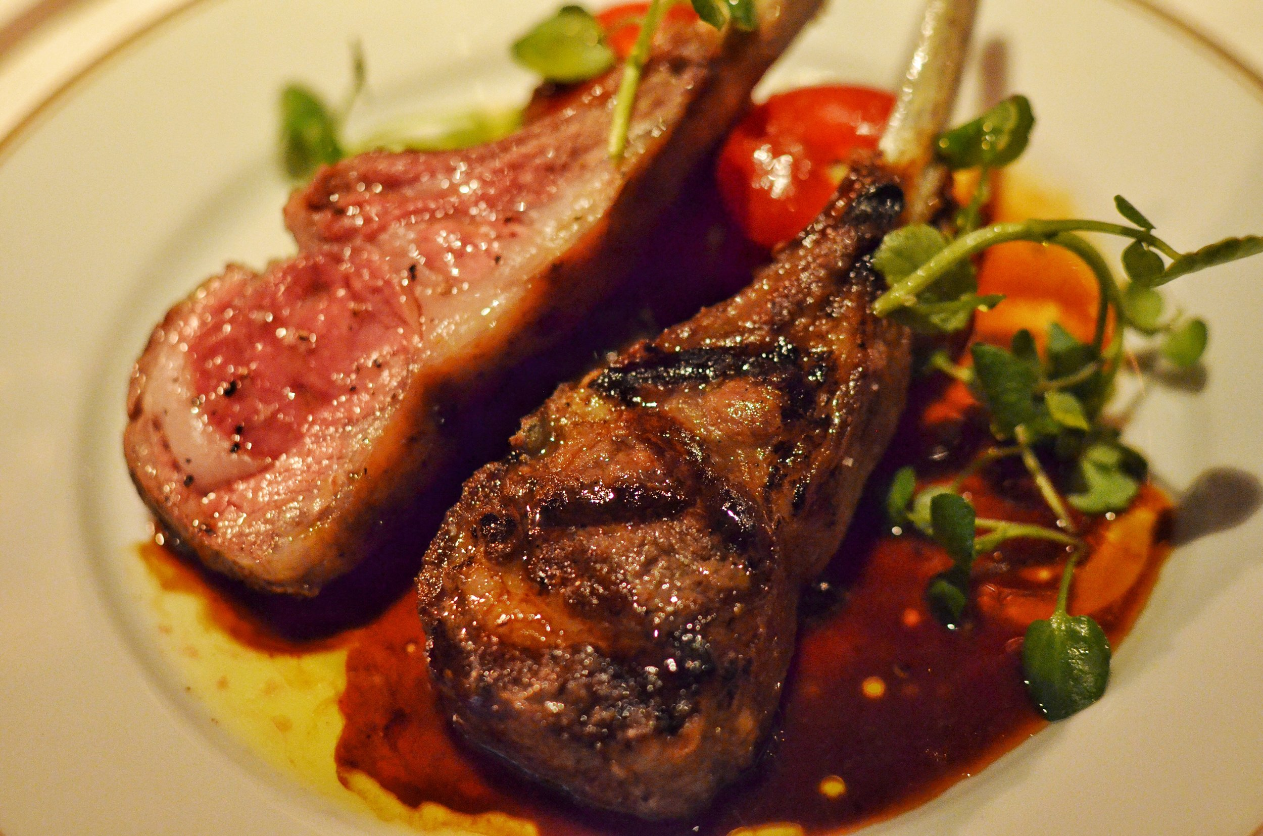"lamb rack, eggplants, tomatoes stuffed with ""choulder and chard"""