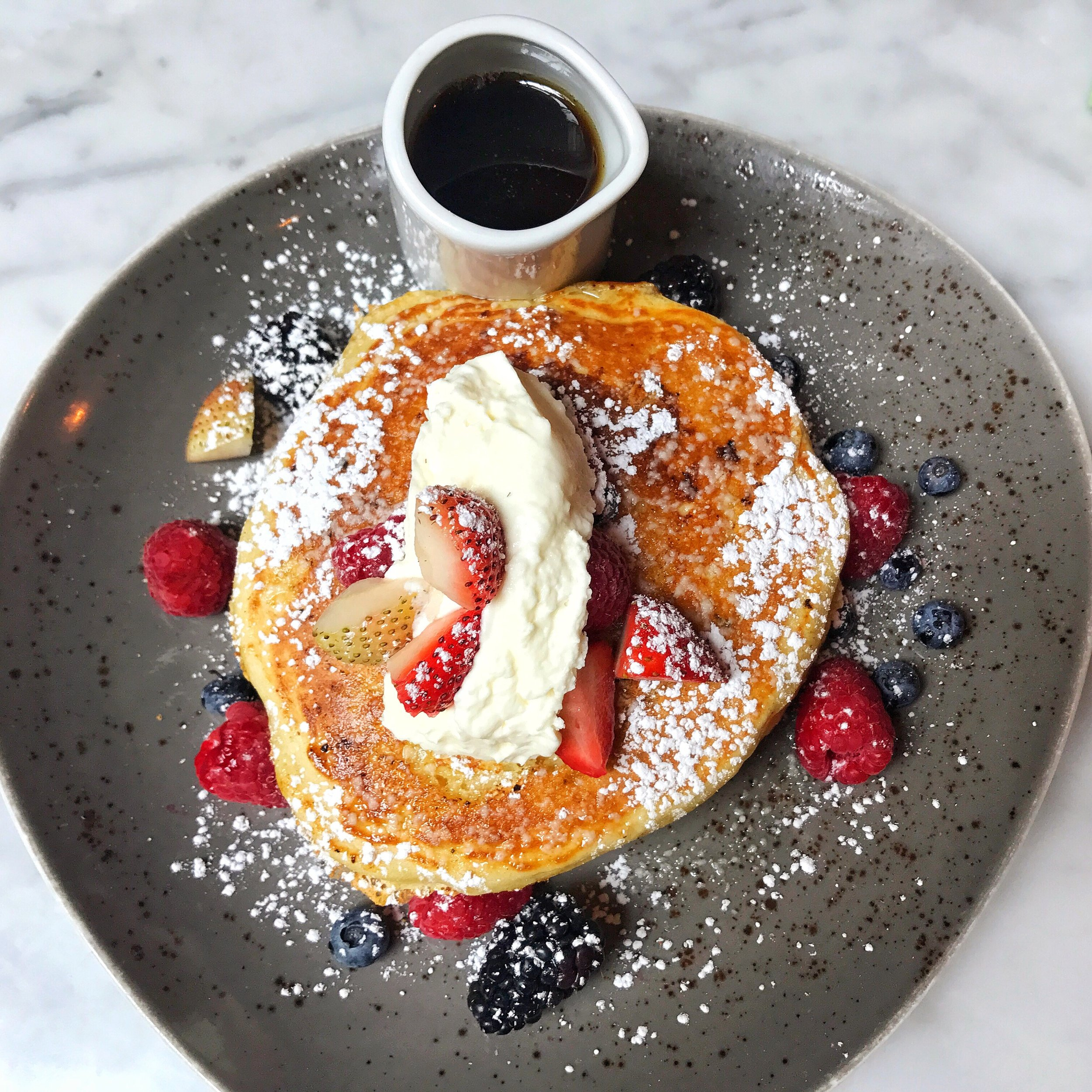 Olive oil Pancakes, mixed berries, chantilly creme, vanilla brown butter and maple syrup