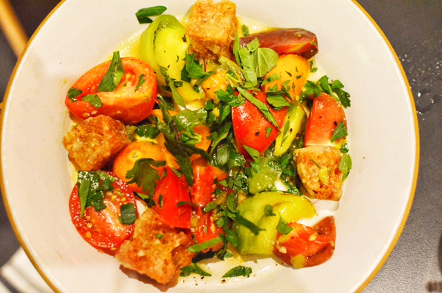 Heirloom tomatoes with parmesan croutons, lemon and herbs
