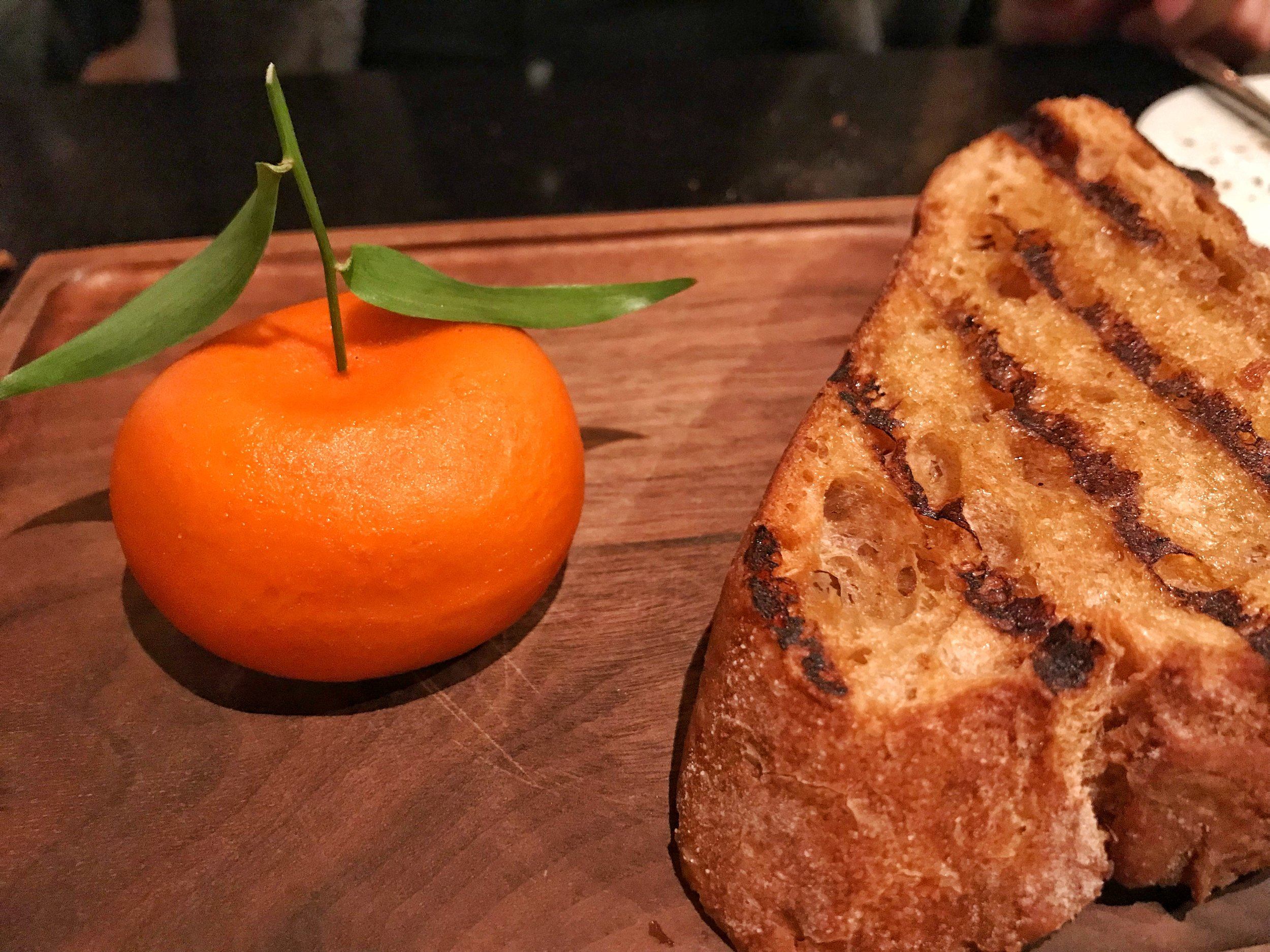 Just a mandarin and grilled bread? I don't think so