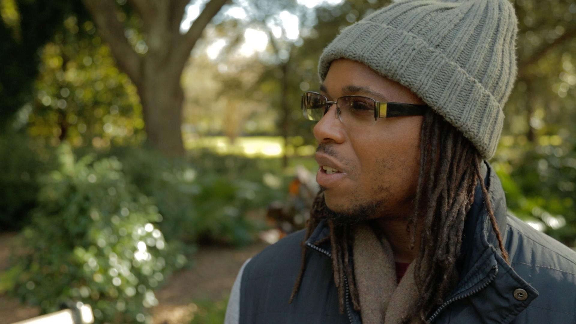 Frame 394 Still024 - Muhiyidin d'Baha of Black Lives Matter Charleston.jpg