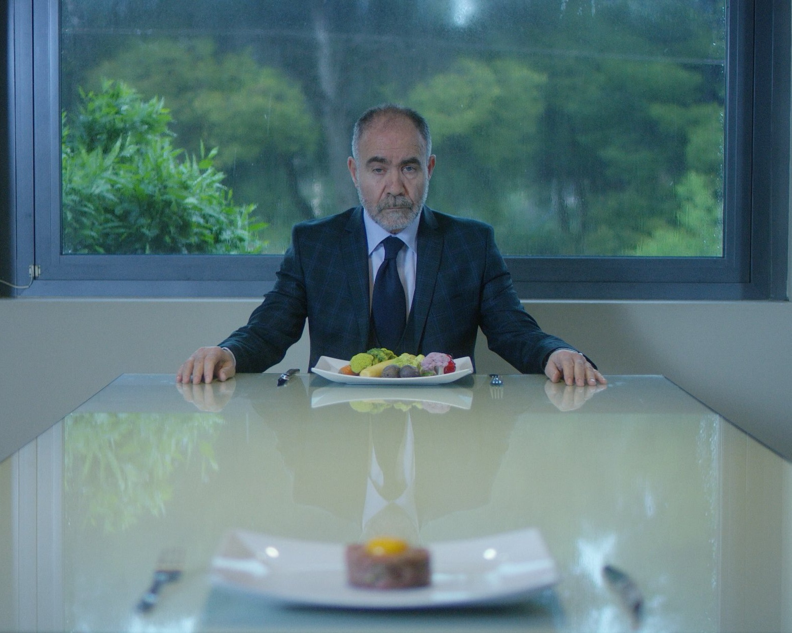Ivan - Directed by Panagiotis Kountouras, GreeceCan you consume your human nature in a meal? When hidden instinct is transformed into morbid obsession, then self-preservation turns into a meaningless ritual of imitation, an act of empty logic.
