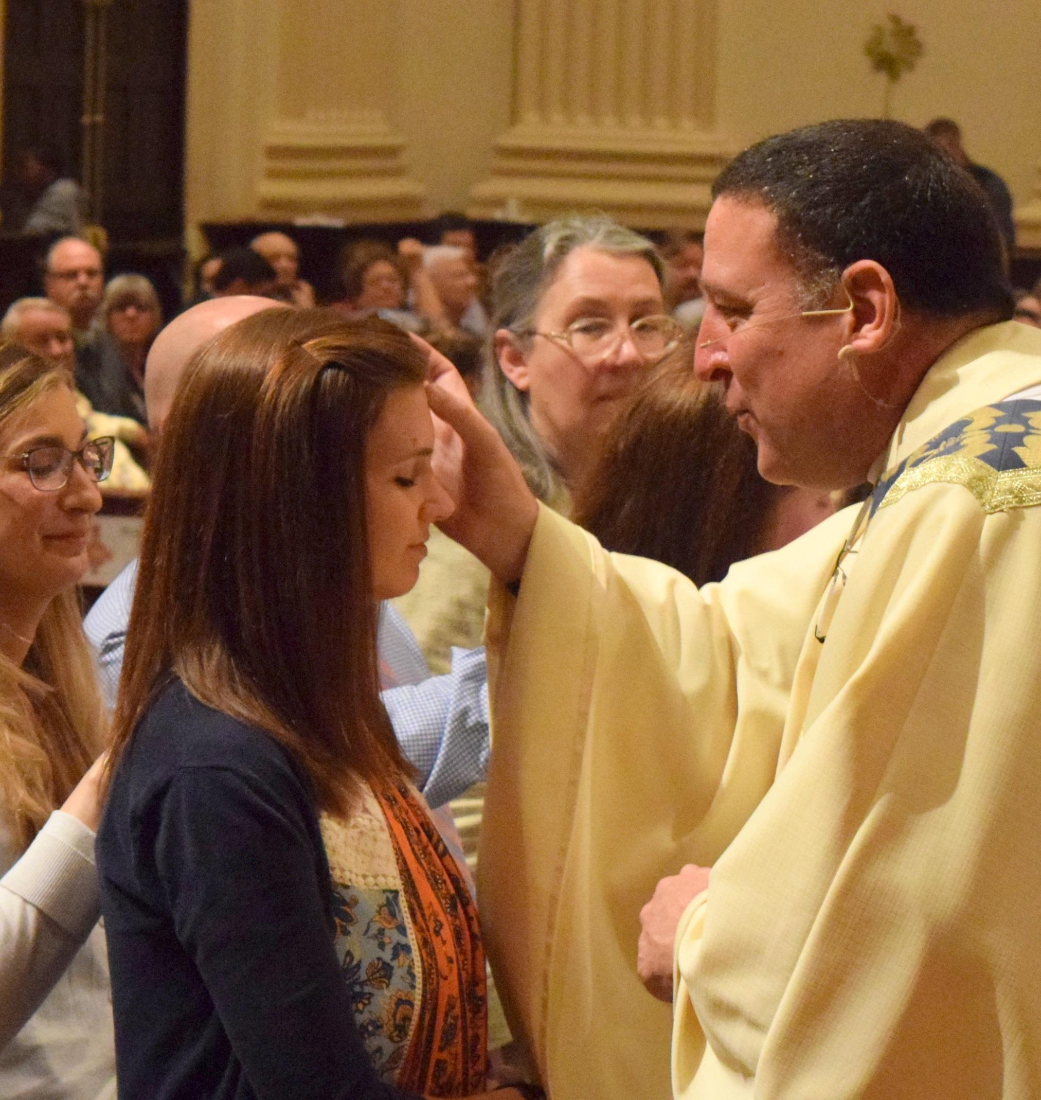 Fr. Kevin blessing candidate.jpg