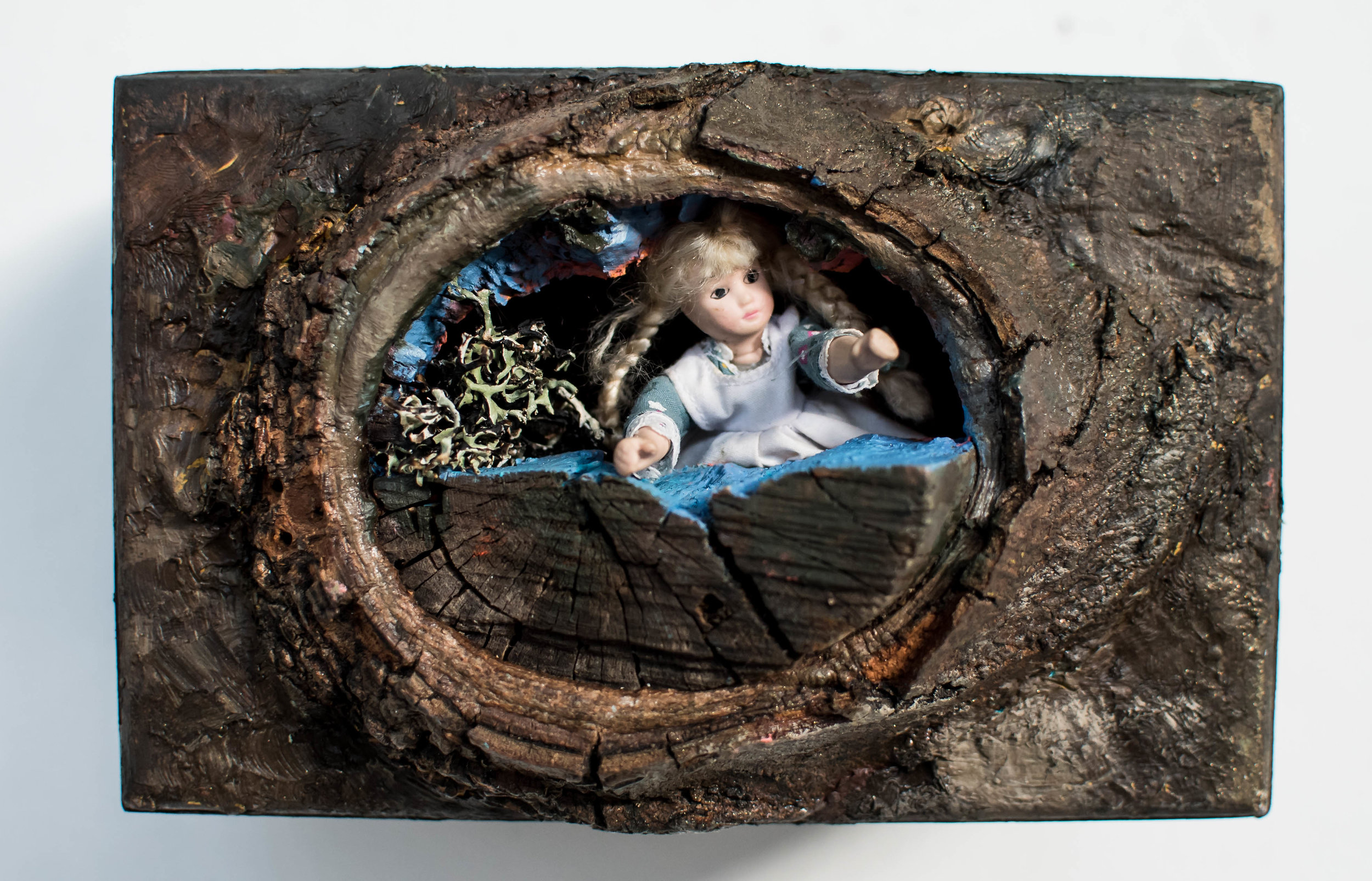 "Alice   up-cycled cigar box with bark knot and peephole featuring miniature Alice figurine and doll house setting  12"" x 6"" x 6"""