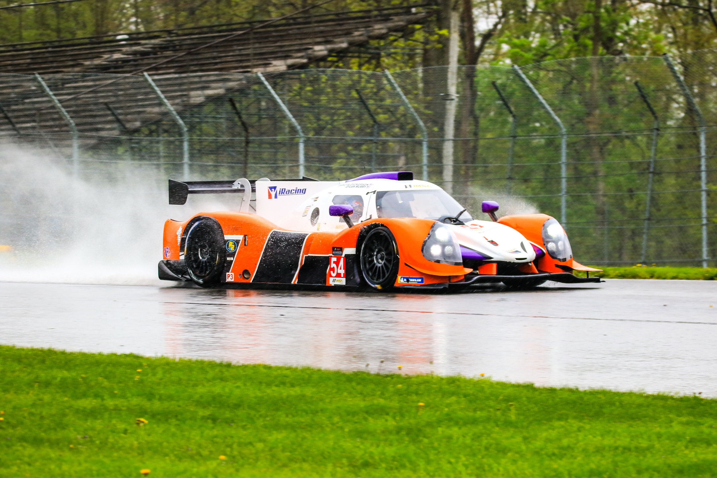 Dickerson racing throught the rain in his Ligier JSP3 at Mid Ohio SportsCar Course.