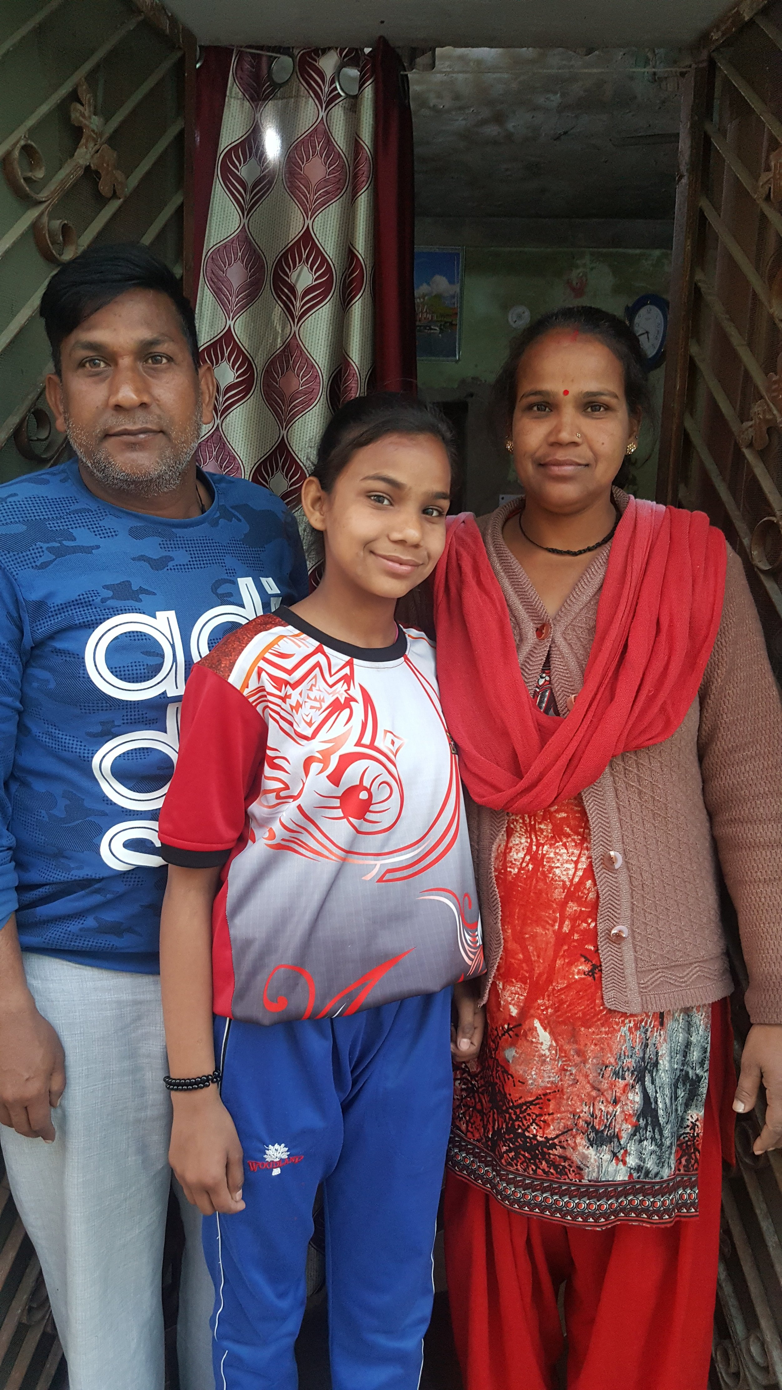 Anjali with her mother and father