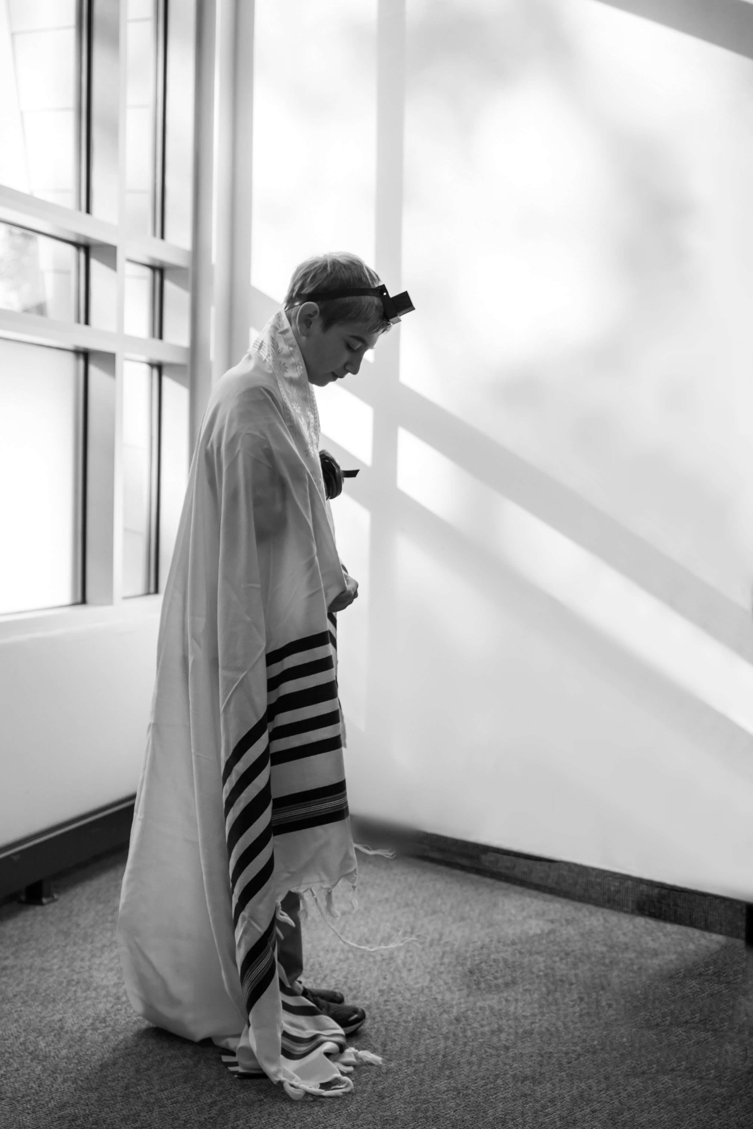 Asher, Meirav's older brother quietly prepares for his sister's big day. -