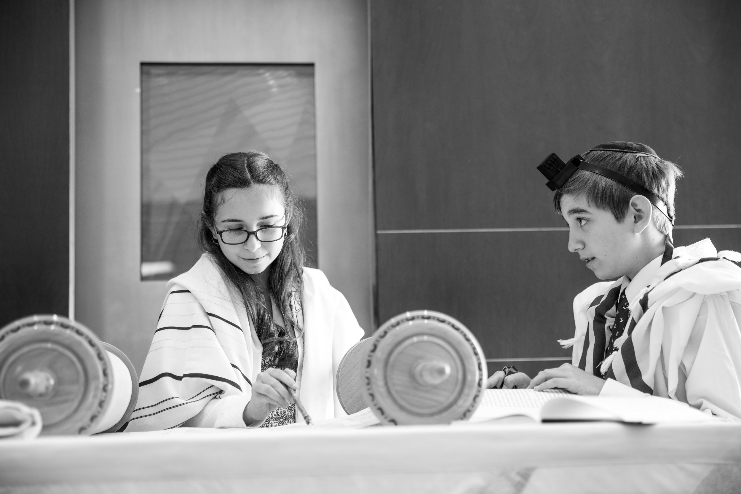 A beautiful moment as Meirav reads from the Torah while Asher lends support when needed. -