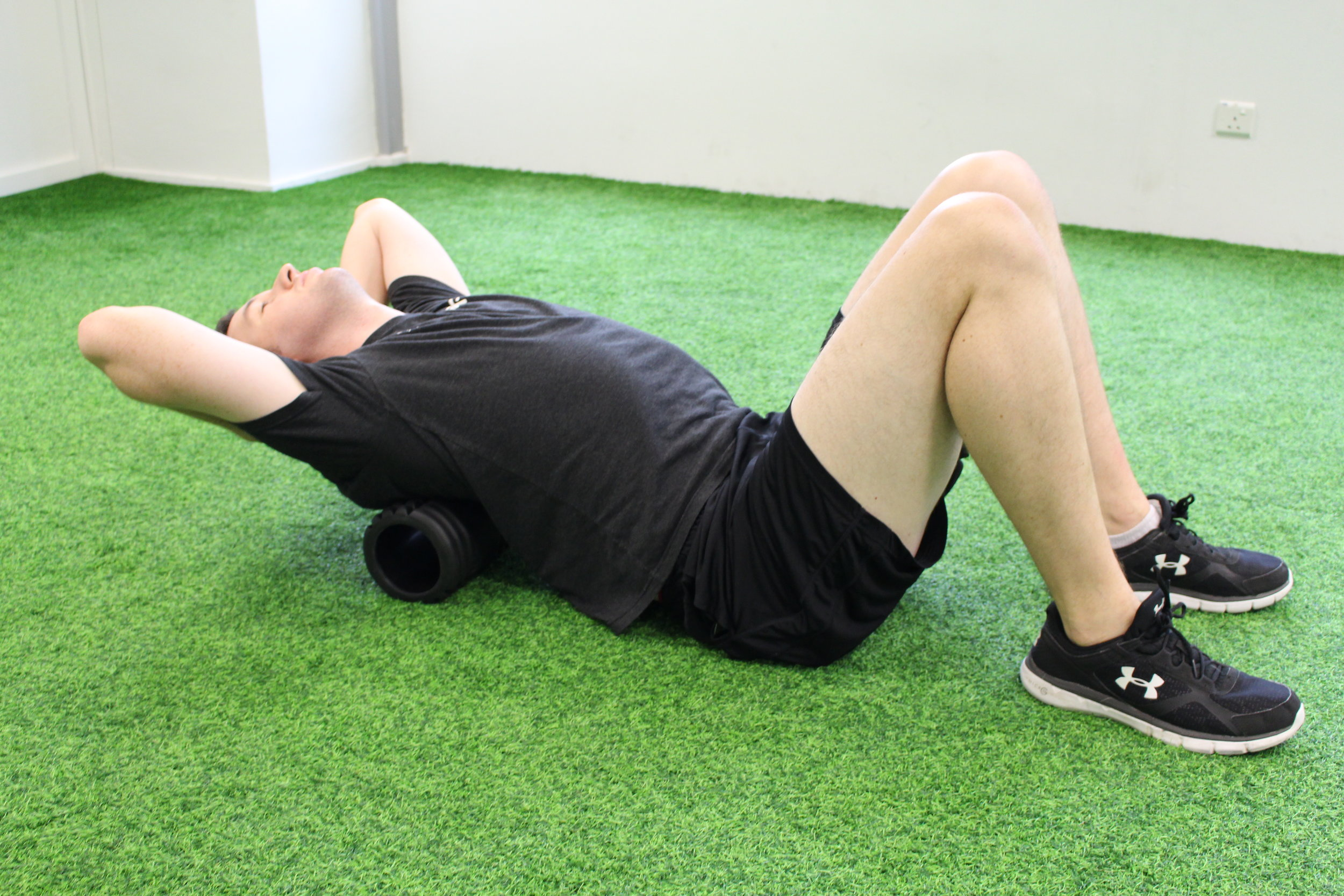 Using a foam roller between the shoulder blades, mobilise the upper back by extending over the foam roller. Hold for two deep breathes and relax. Repeat eight repetitions.
