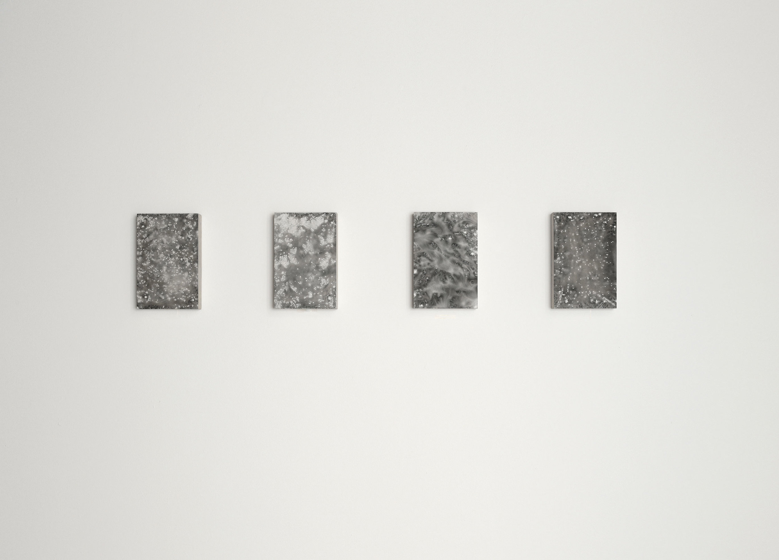 left to right:    ABUNDANT LIGH T (II),  ABUNDANT LIGHT (III)     RESONANCE (I), ABUNDANT LIGHT (I)    2009  carbon deposit on limestone 20.8 x 14.0 x 4.0 cm