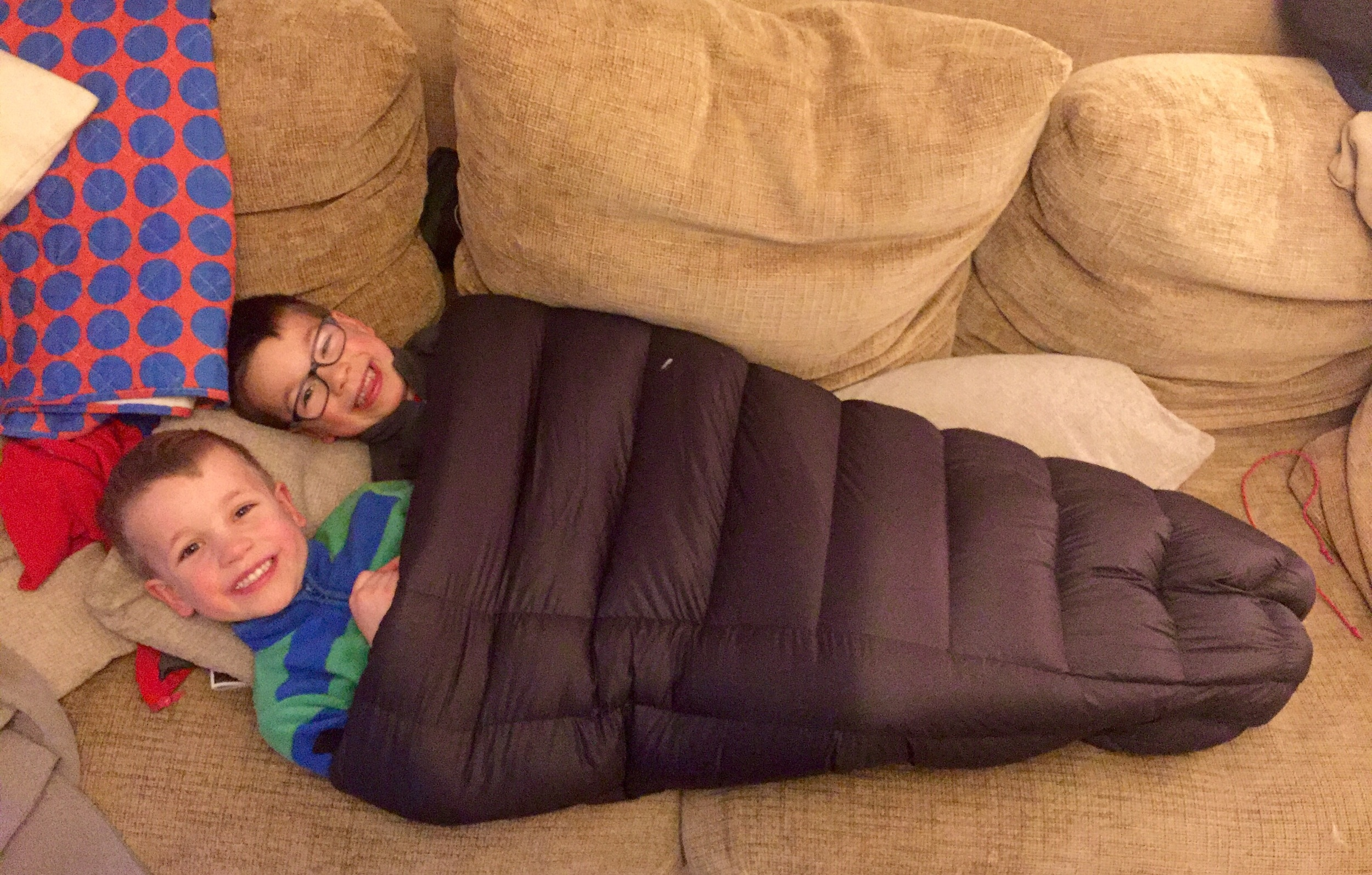 Two boys in 0.5 of a sleeping bag