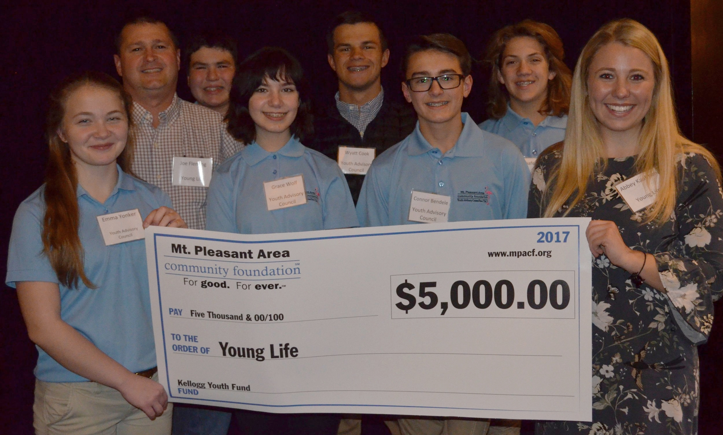Members of the MPACF Youth Advisory Committee present a check to representatives of Young Life to support a mentoring program for sixth grade students at Mt. Pleasant Middle School.