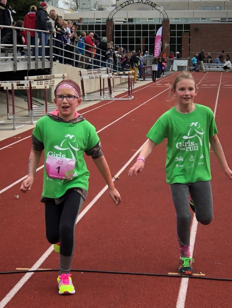 Two girls near the finish line during the 5K Celebration Run.