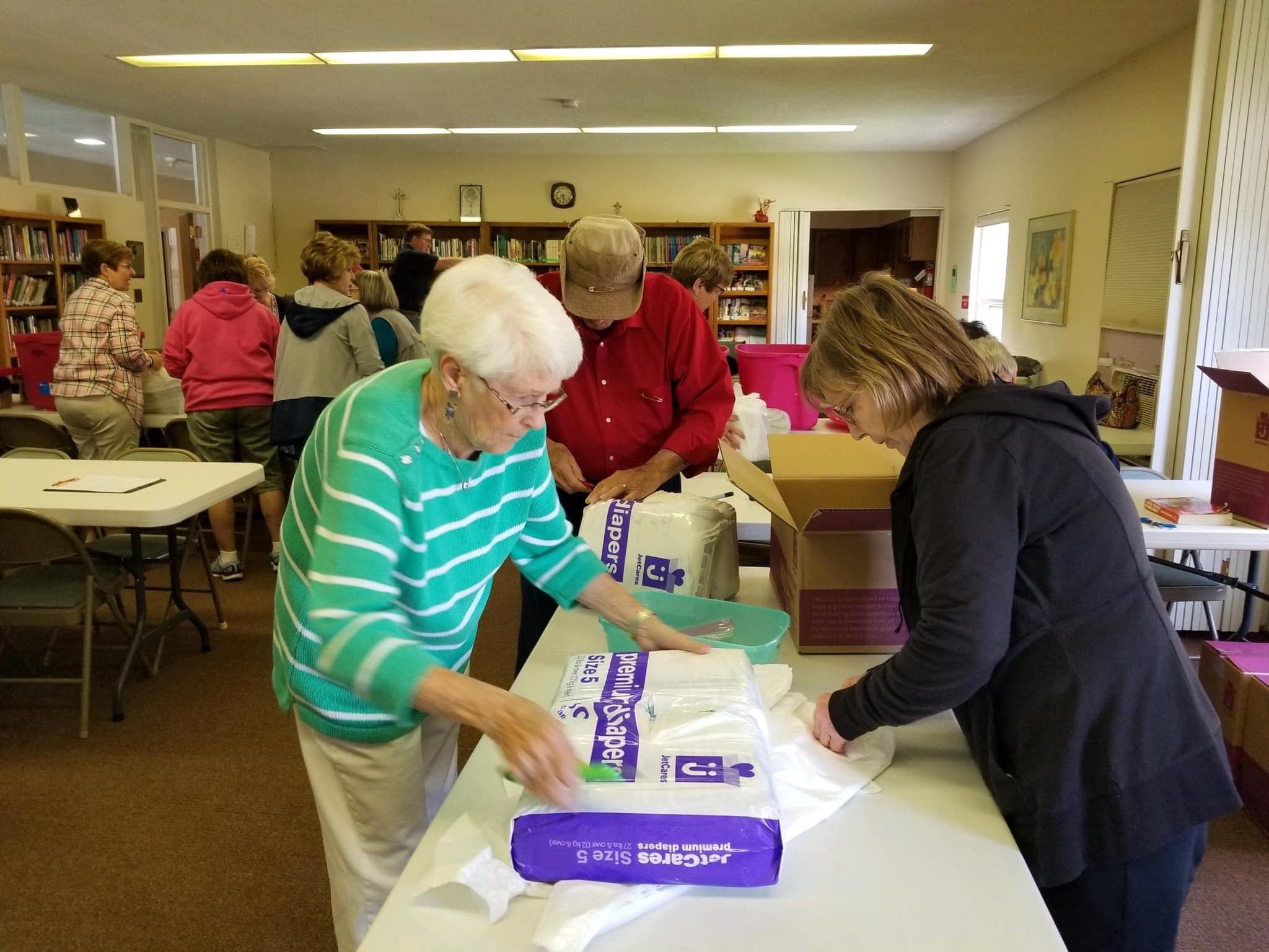 Volunteers assist in packing diapers for Isabella County families in need.