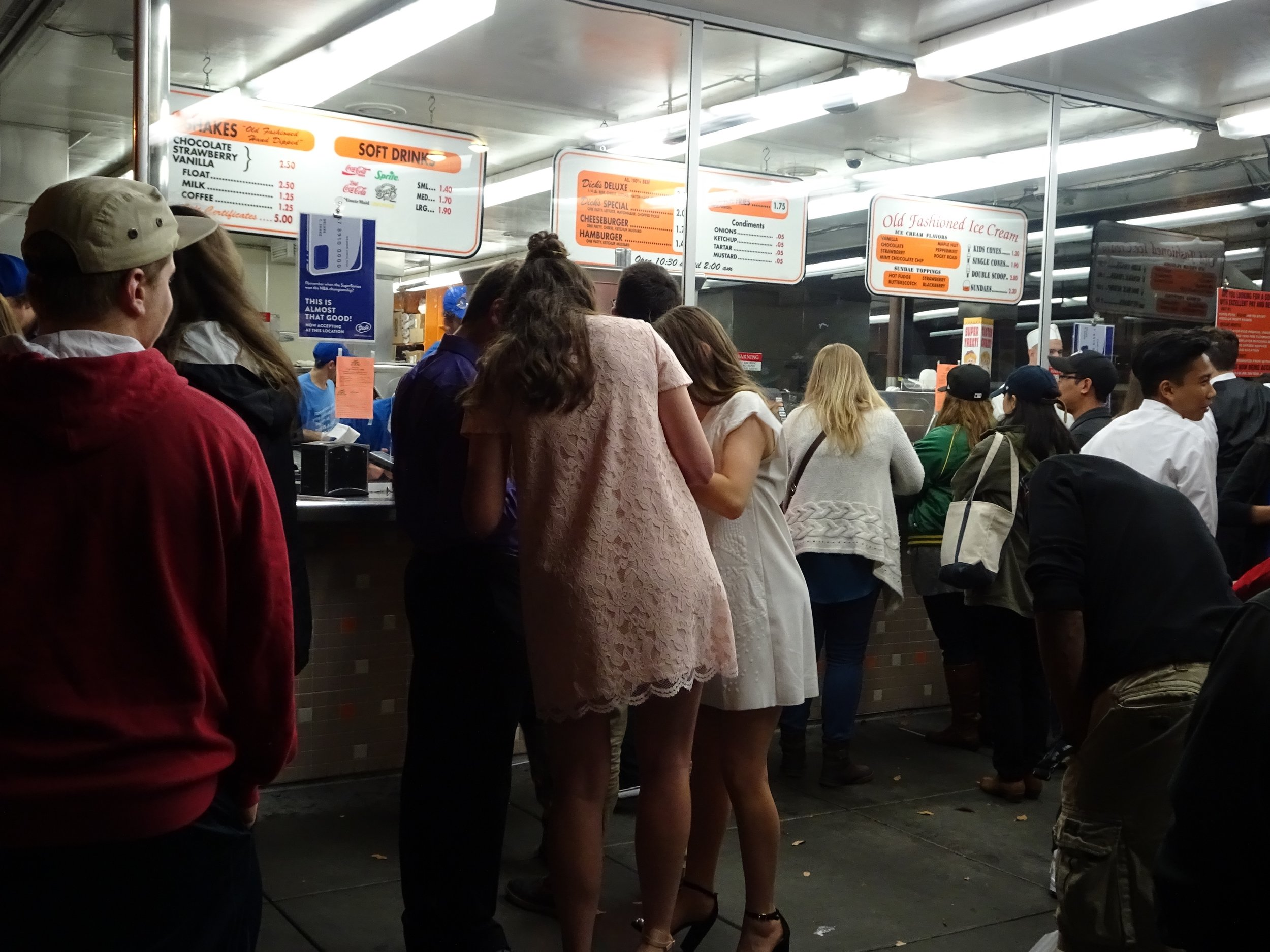 late night crowd at dick's, seattle, washington - m.quigley