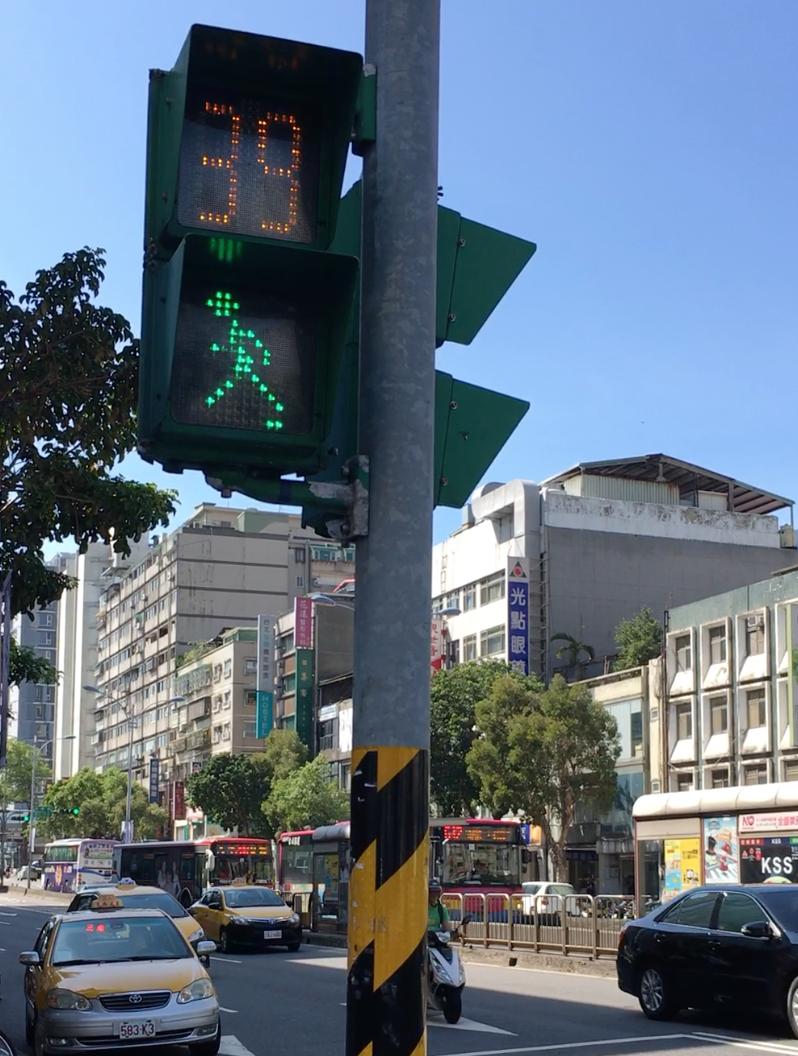 crosswalk man in taipei, taiwan - m.
