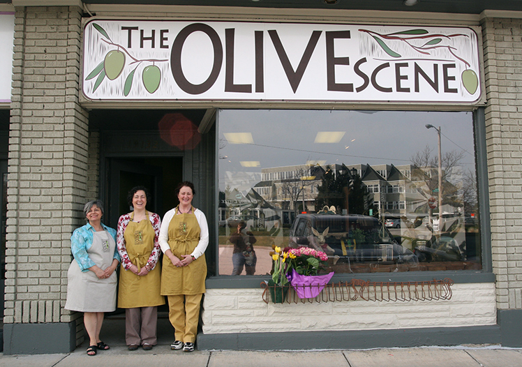 Visit The Olive Scene at 19132 Old Detroit Road in the Old River Shopping Area.