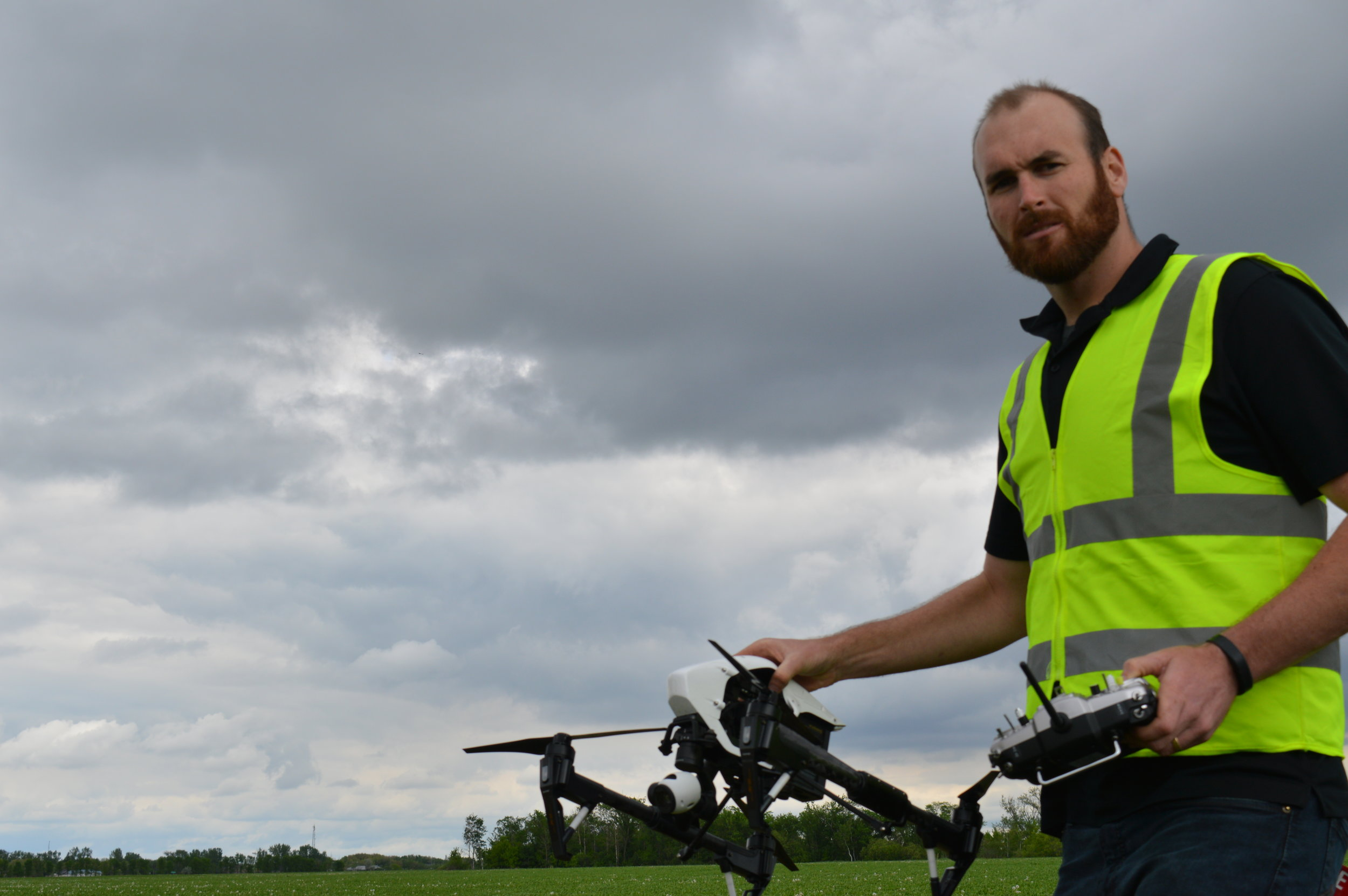 Matthew Johnson, owner of M3 Aerial getting ready to launch the DJI Inspire 1. You can gather NDVI when it is cloudy, but try to avoid collecting when there are spotty cloud cover that casts temporary shadows on the field during your flight...