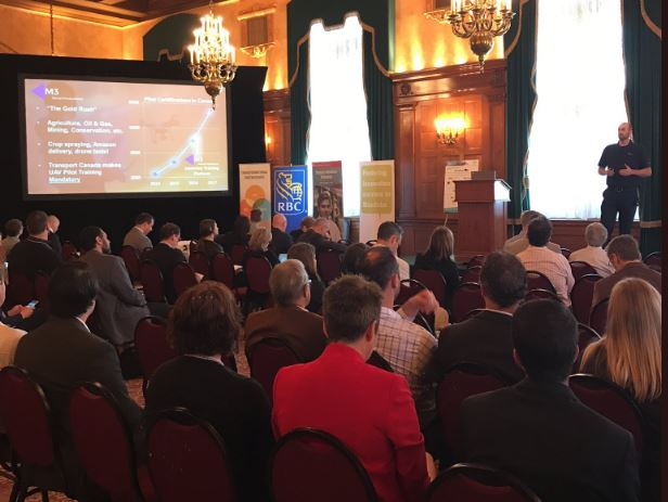 Matthew Johnson, President of M3 Aerial Productions, speaks to a packed room at the Fort Garry Hotel in Winnipeg about Drone Training and the M3 Aerial Network.