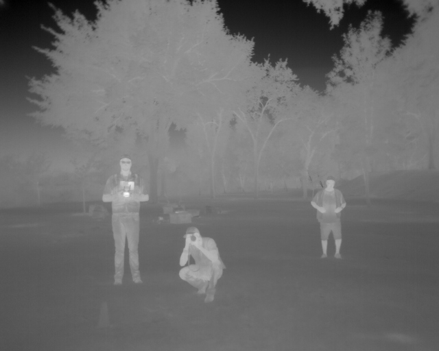 Thermal infrared image taken of the PIC (pilot-in-command), VO (visual observer), and our SP (support personnel). Thermal sensors can be used to detect people who are lost in rugged landscape. Check out our Search and Rescue initiative Quick Reaction Force Search And Rescue ( QRFSAR ).