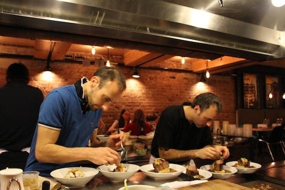 Chefs in the open kitchen at  La Fabrique Bistrot , Montréal