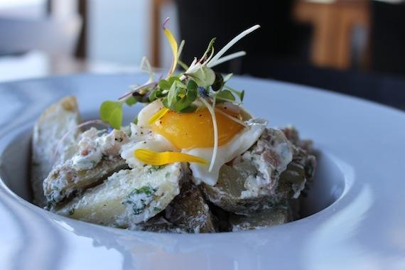 Potato salad with kale, bacon and soft boiled egg at  Bota Bota Spa , Montréal